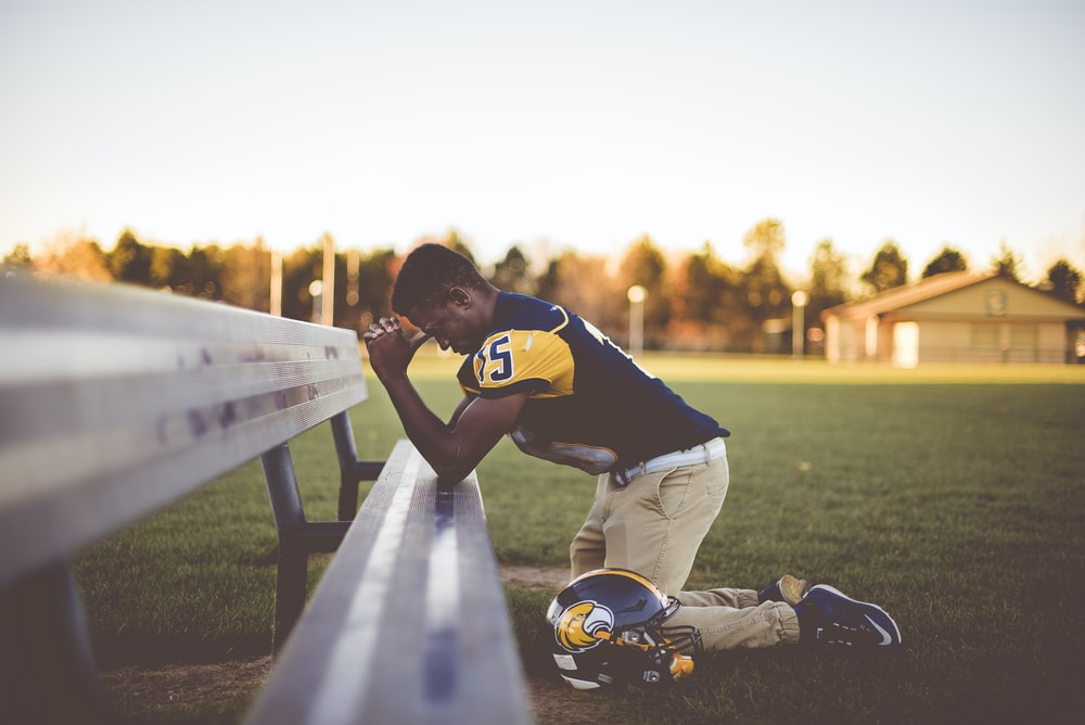 baseball player kneeling on ground