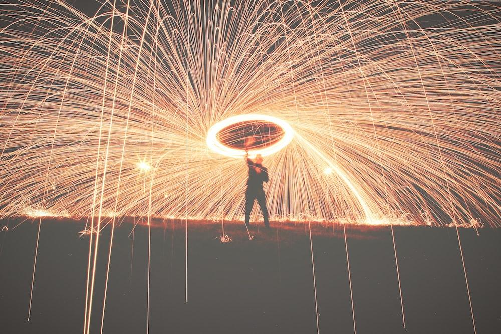 man holding fireworks