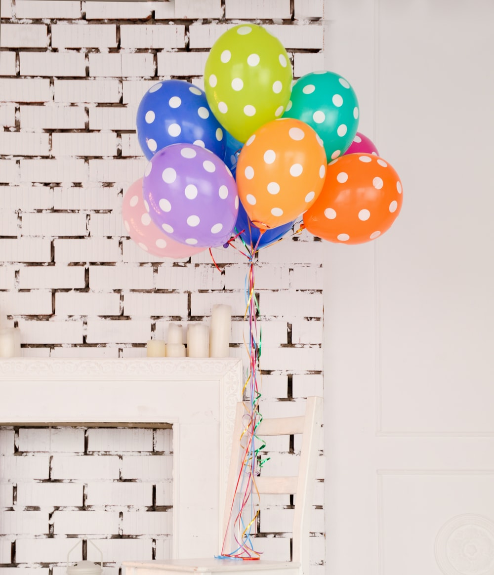 assorted-color polka dot balloons