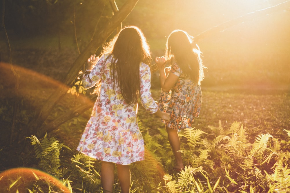 two women running around woods