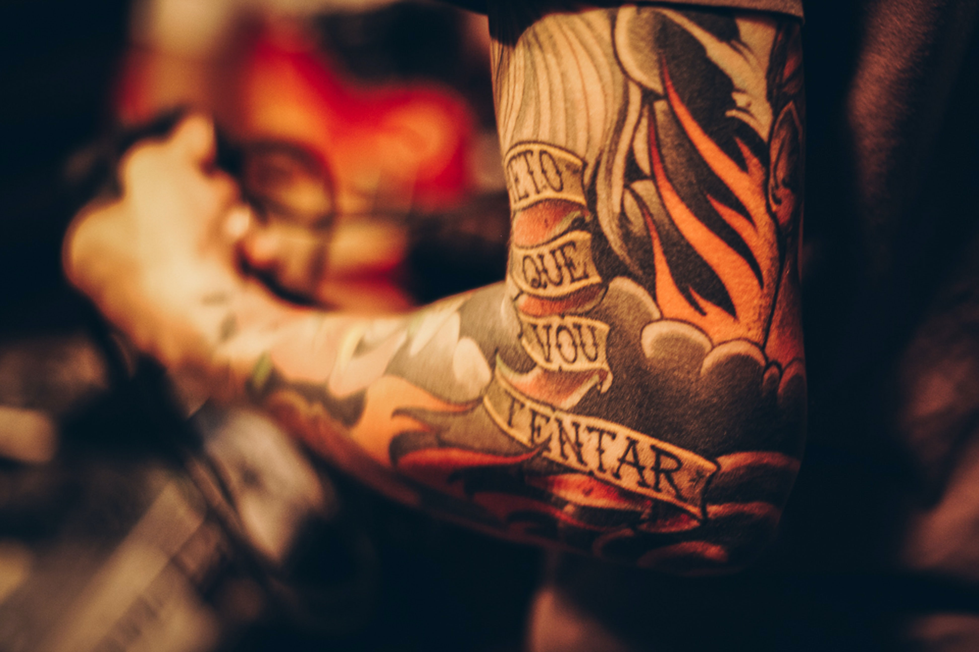 Close-up of a person's tattooed arm