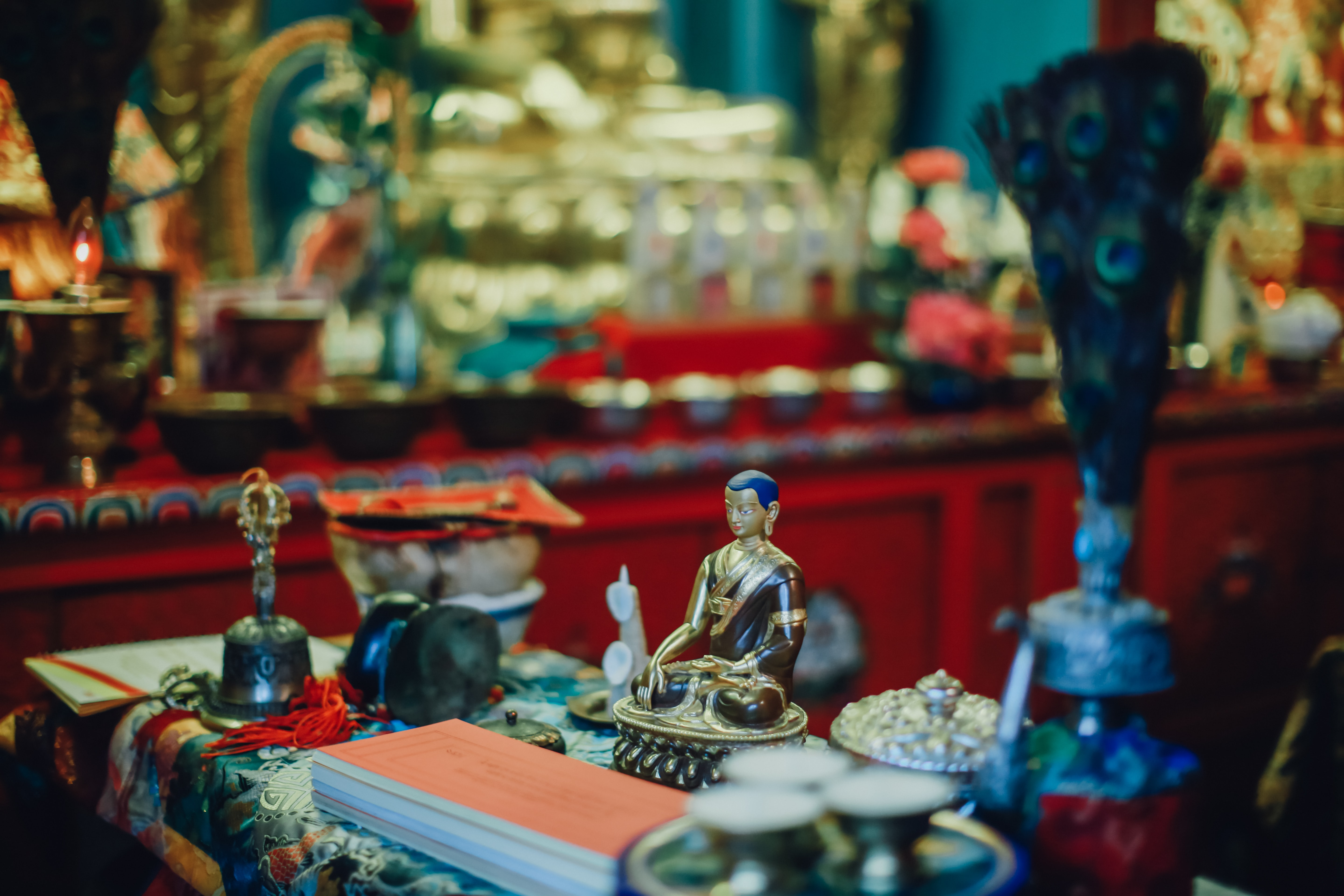 Religious statues and offerings inside a temple