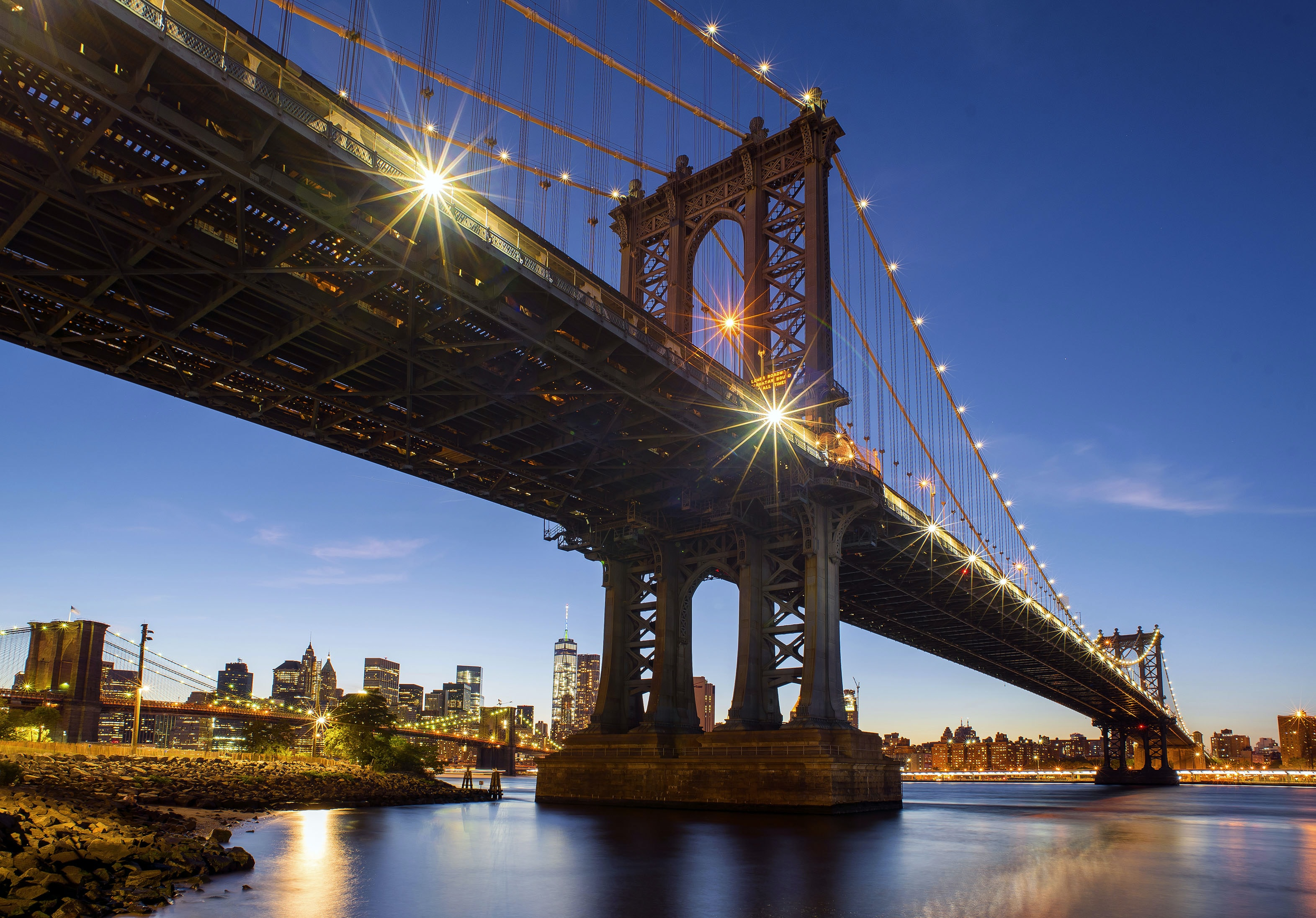 The Manhattan Bridge in New York City lit up at night