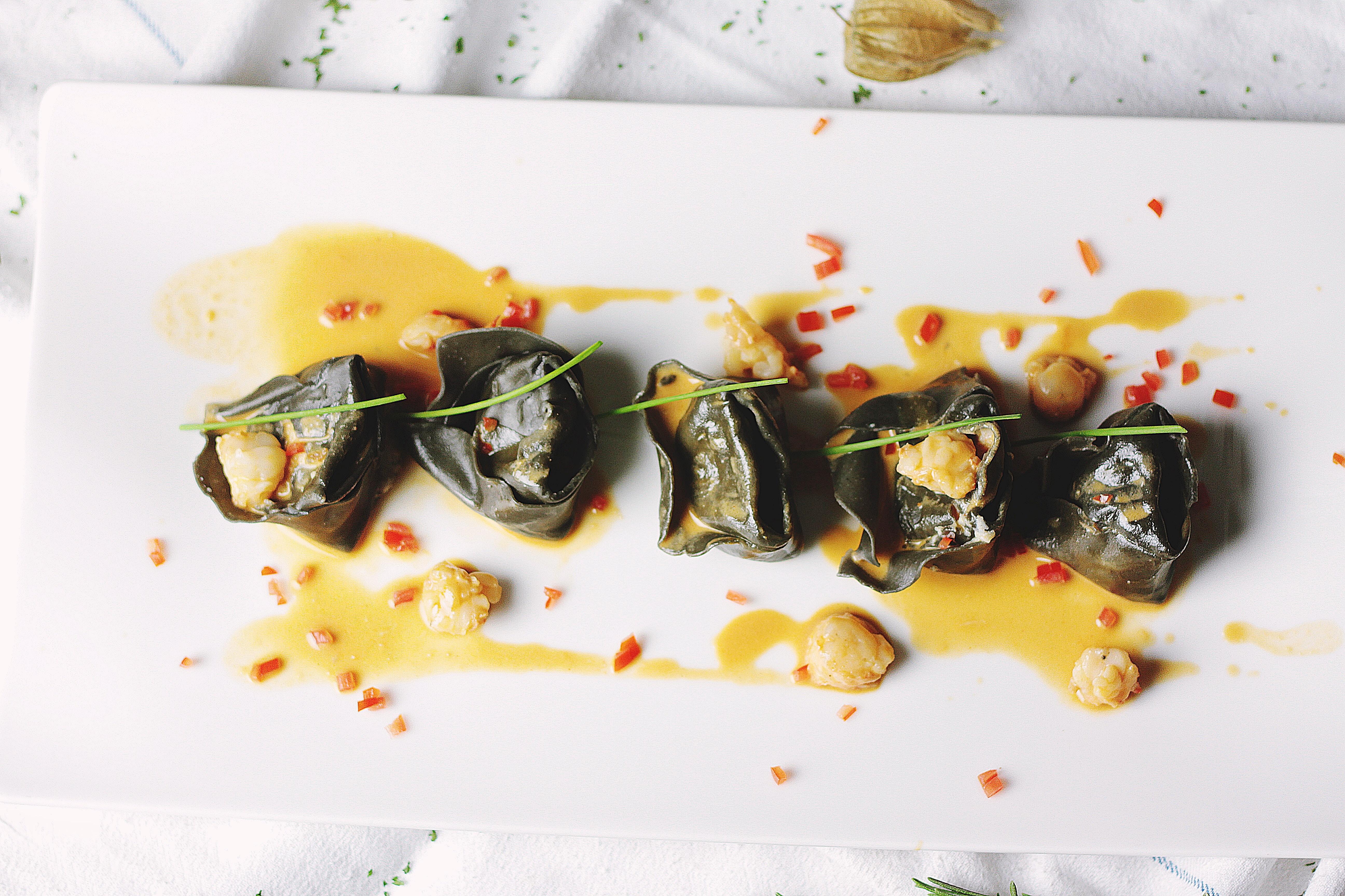 An overhead shot of an Asian dish on a white platter