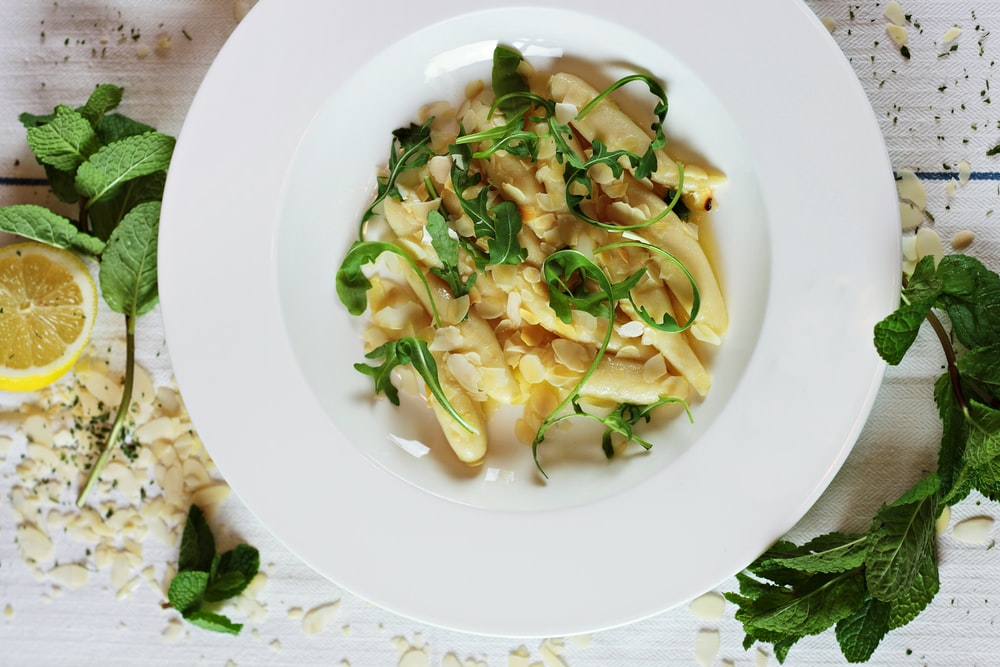 round white ceramic plate with pasta