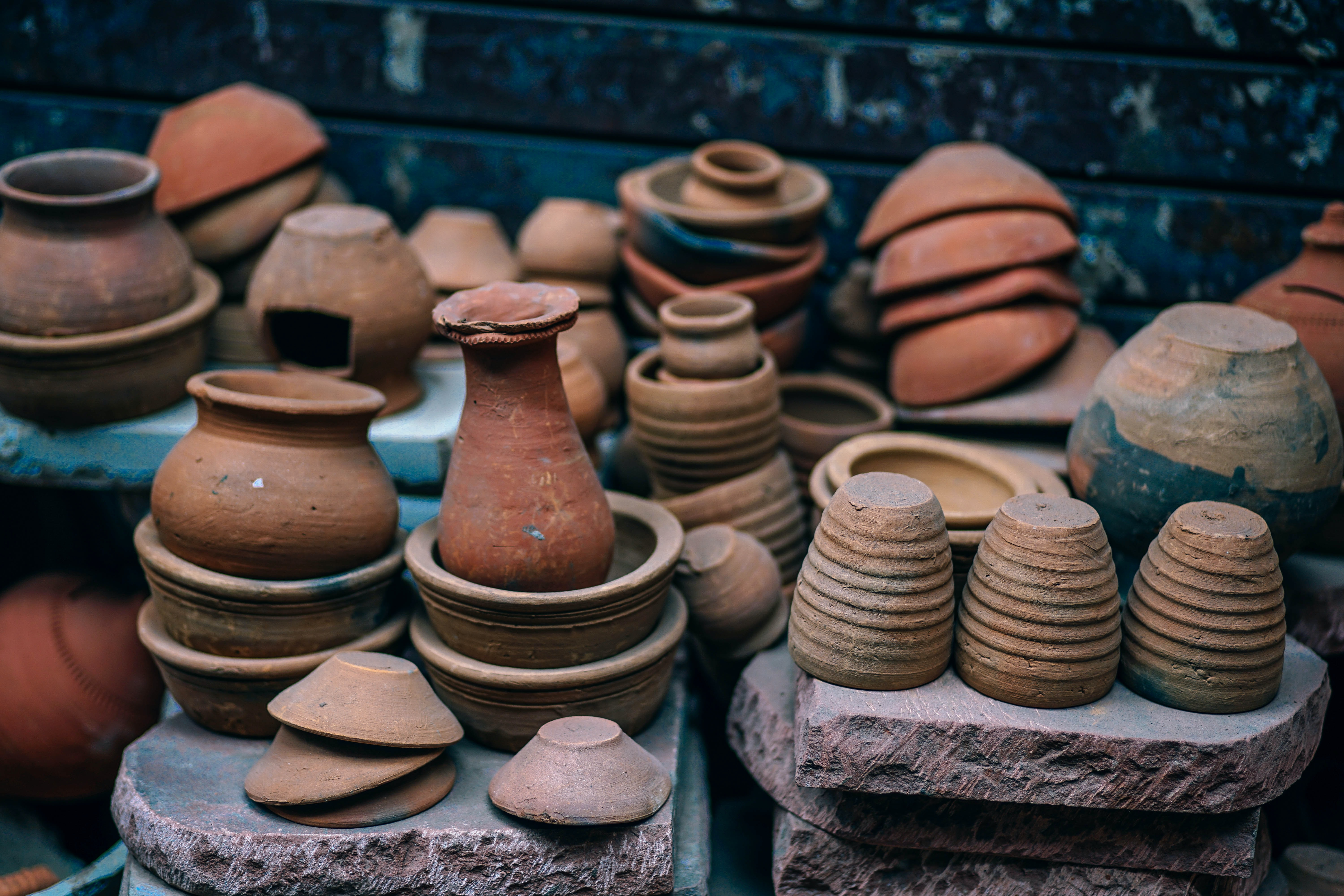 Stacks of pottery near a wall