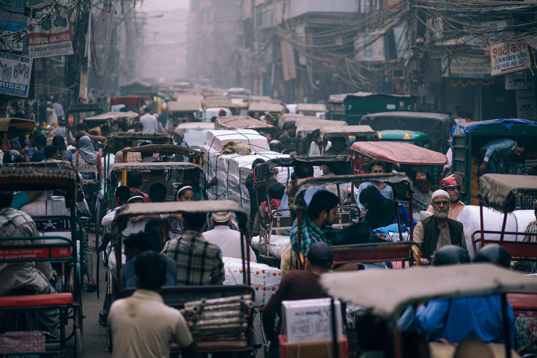 people riding auto rickshaws on street