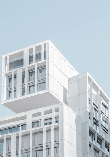 A white concrete apartment building in Madrid