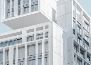 white modern cement building under blue sky