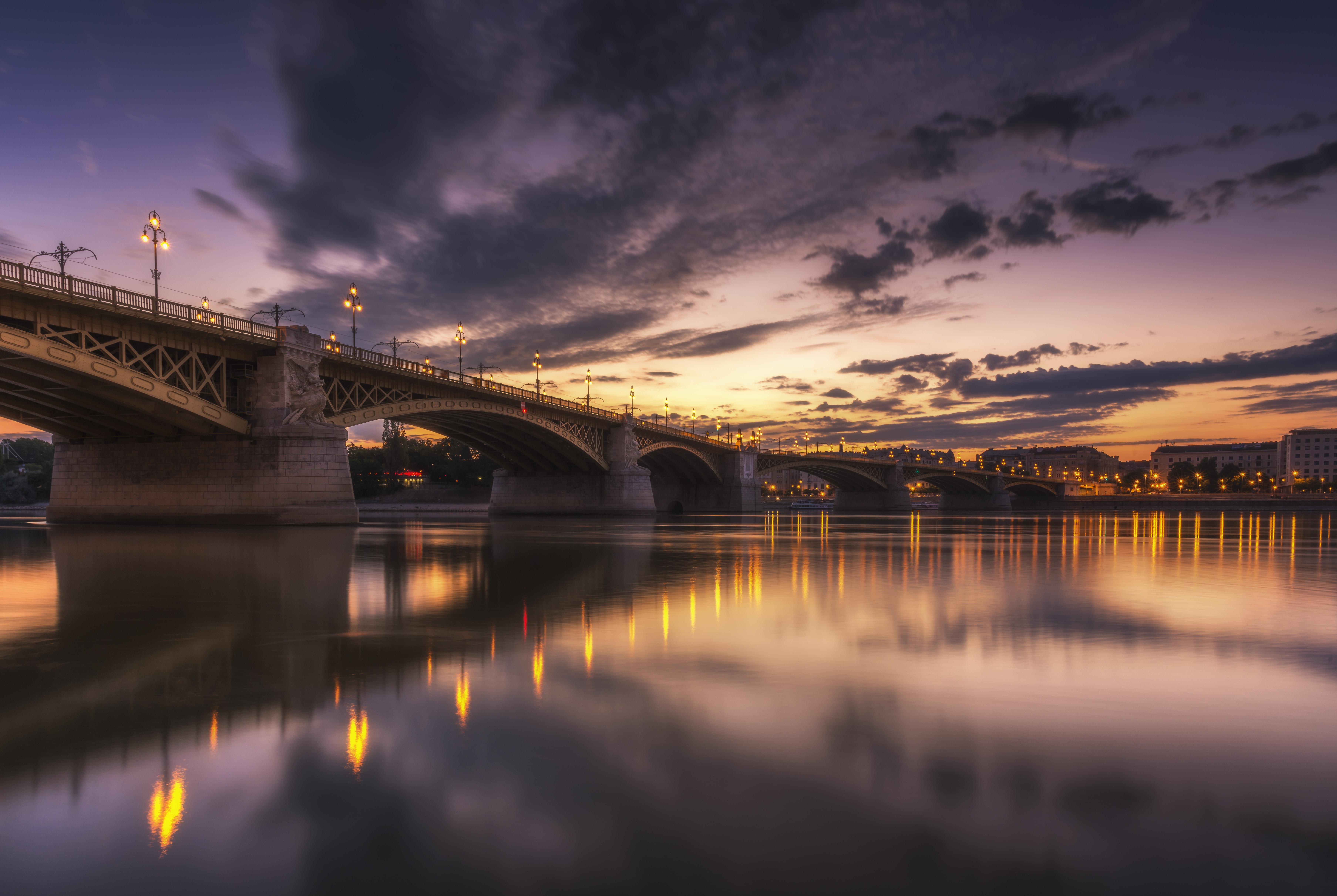 gray concrete bridge under cloudy sky