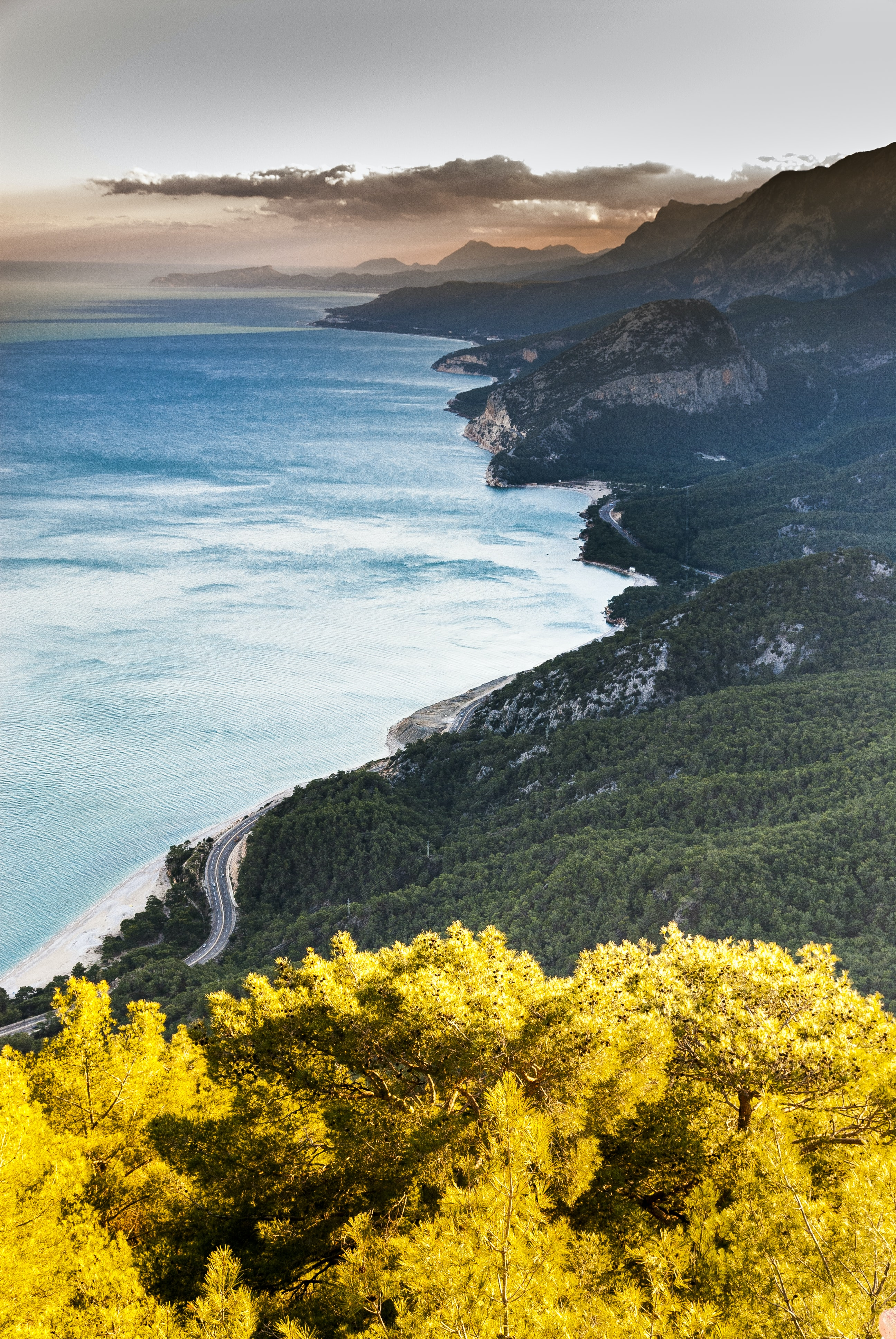 Hilly green shoreline with the winding road at Antalya