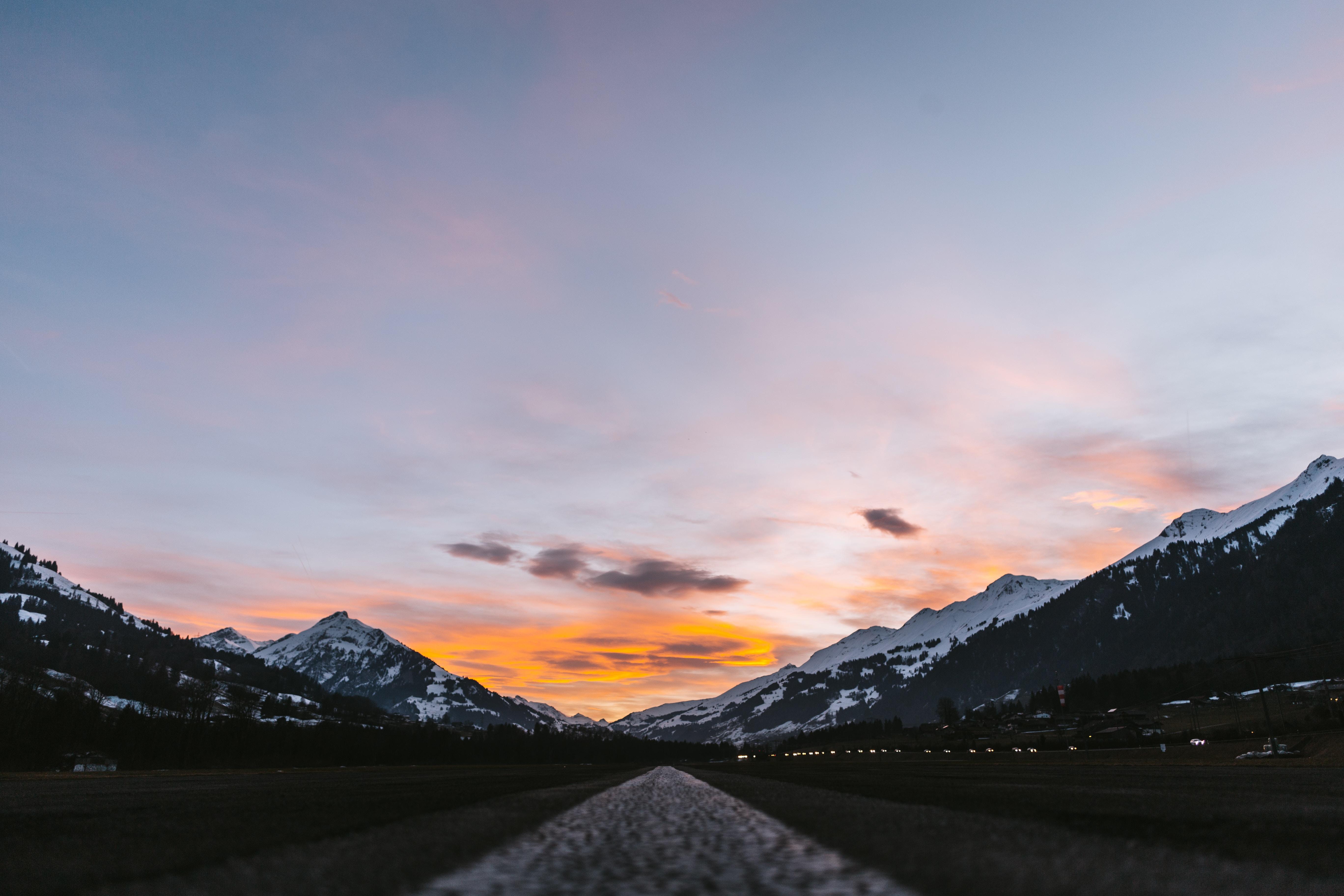 A low shot of an asphalt road running through a mountain valley in Adelboden