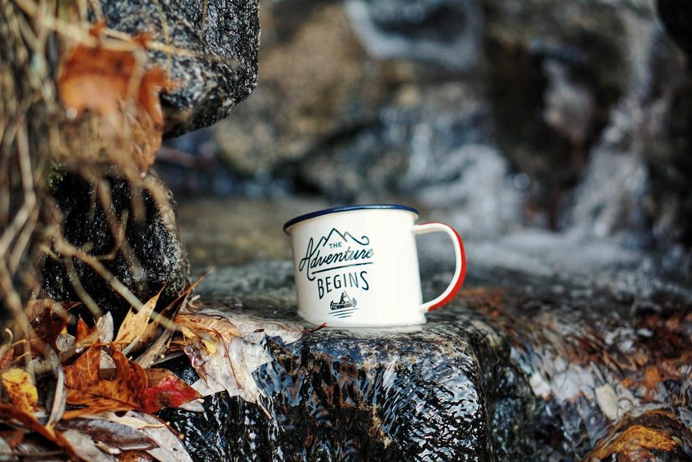 macro shot of white ceramic mug on waterfalls
