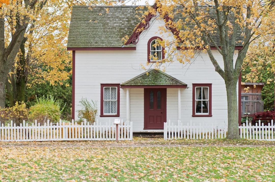 white house under maple trees