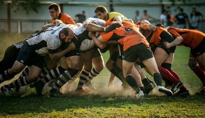 men playing football rugby teams background