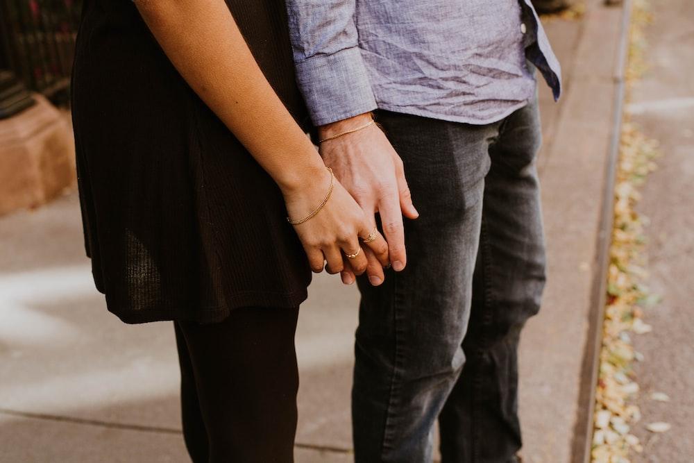 woman touching man's hand