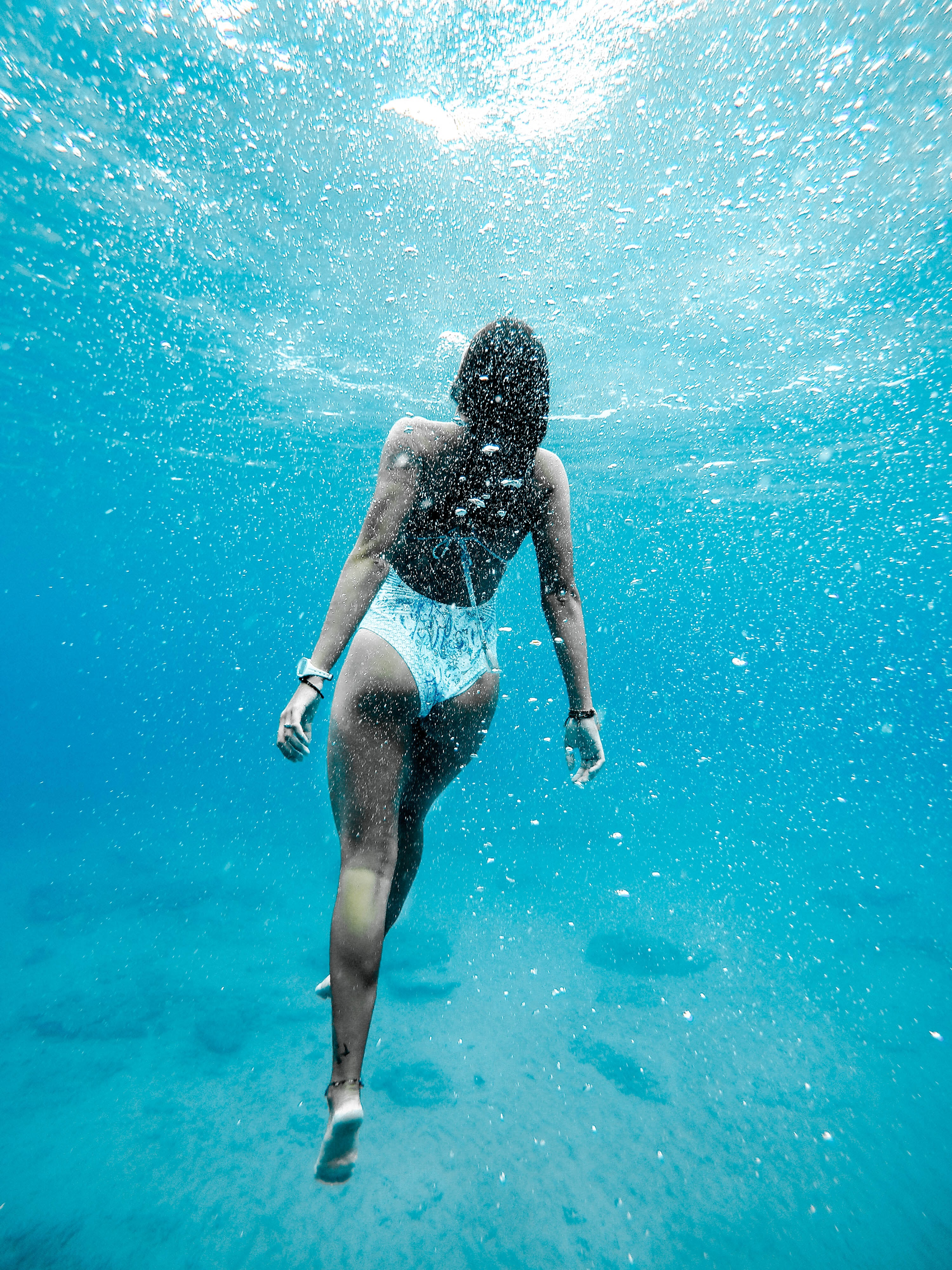 A woman in a bikini swimming underwater