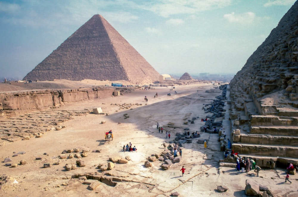 structural shot of brown pyramid under blue sky during daytime