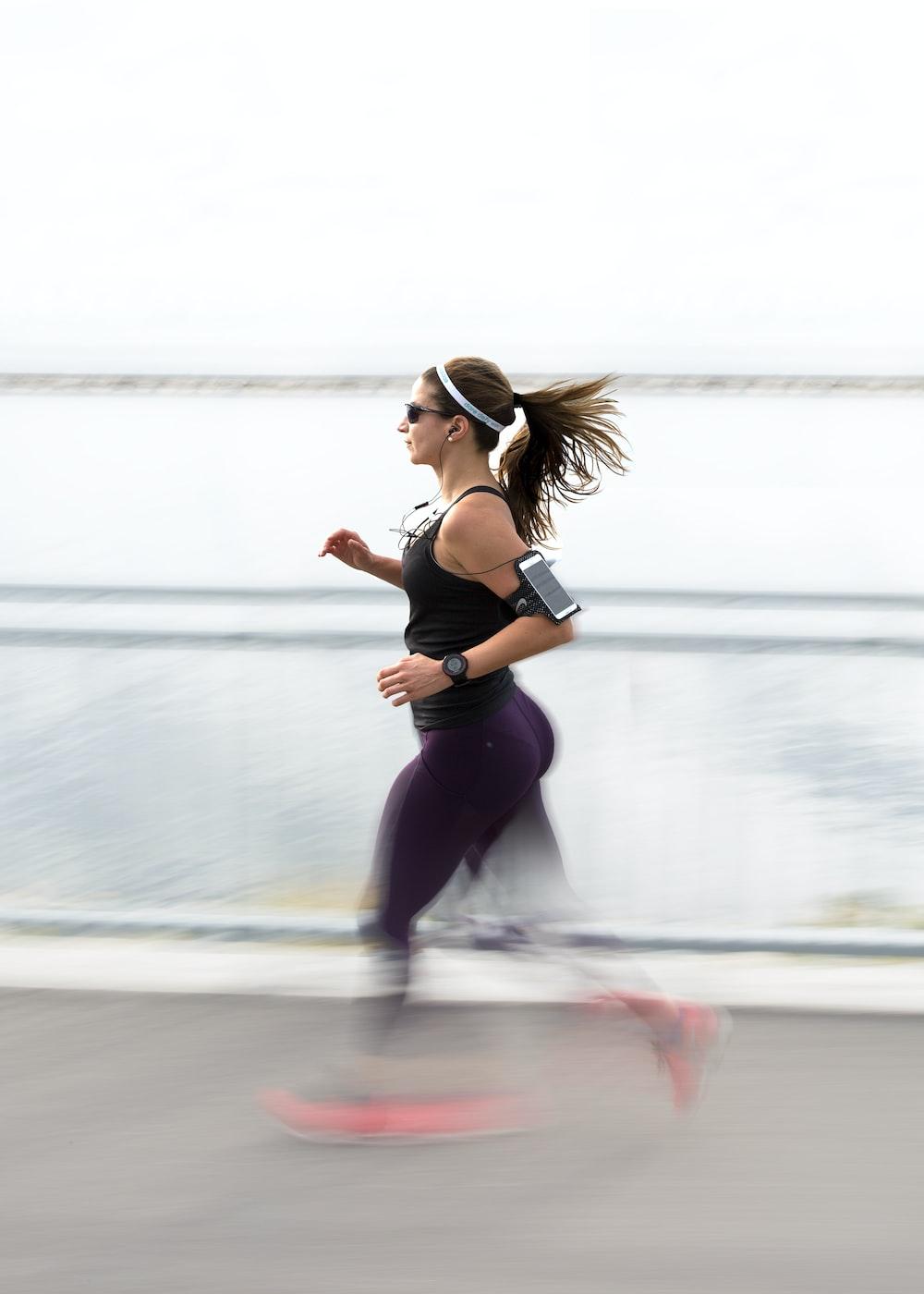 woman running wearing armband