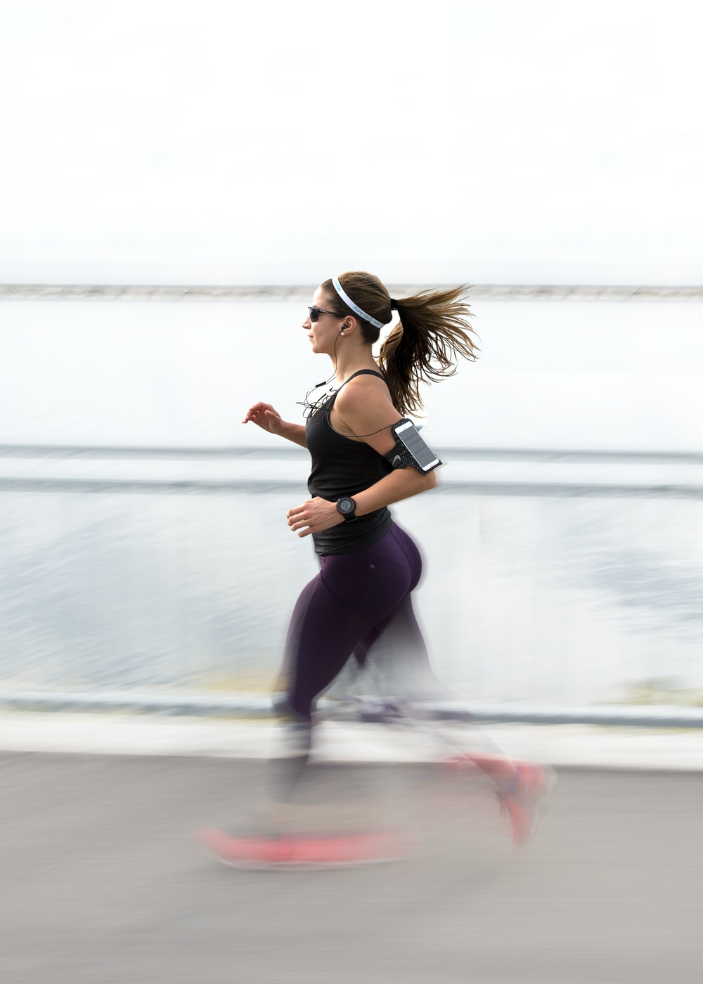 woman running wearing armband