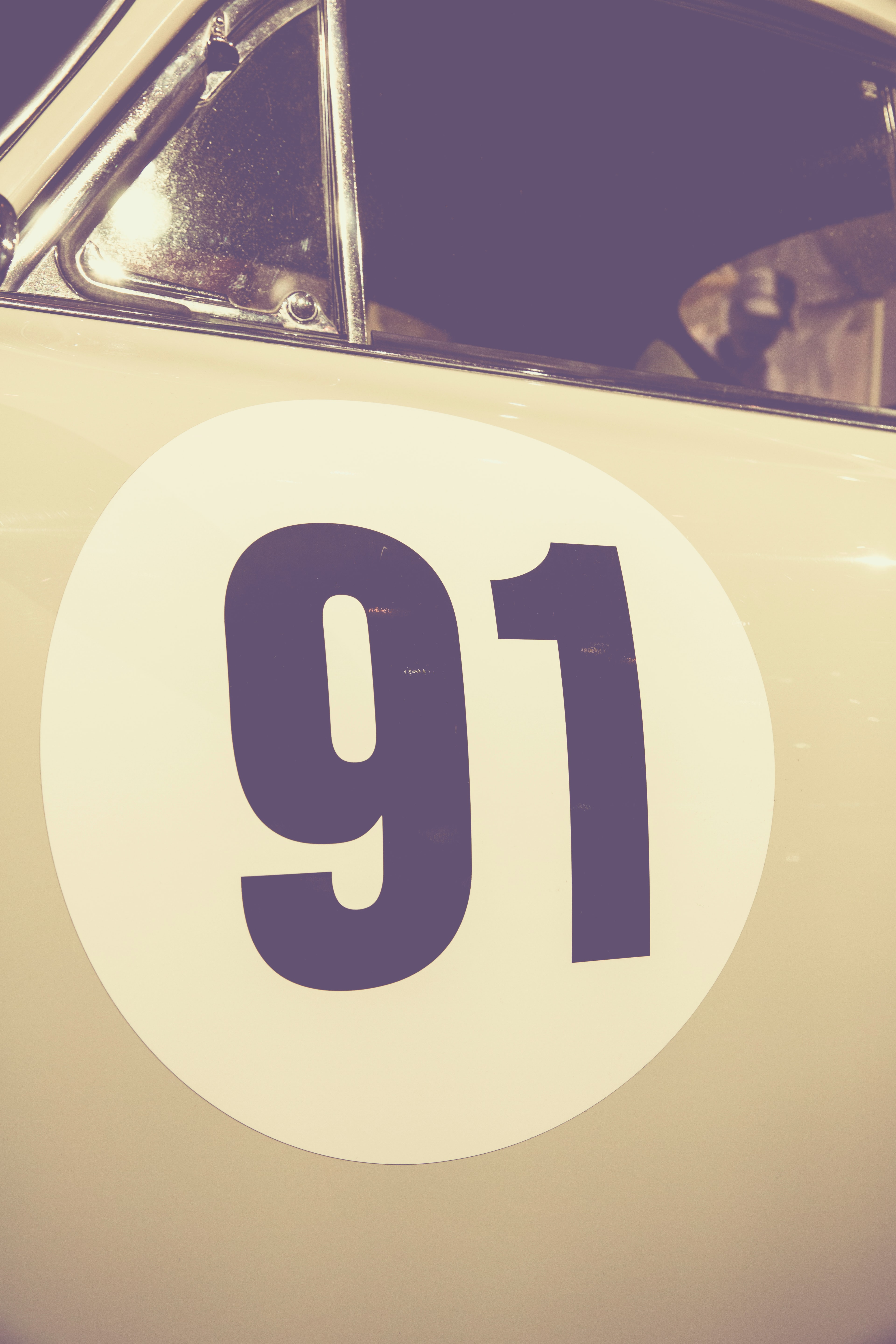 A car with a 91 decal on the driver's door.