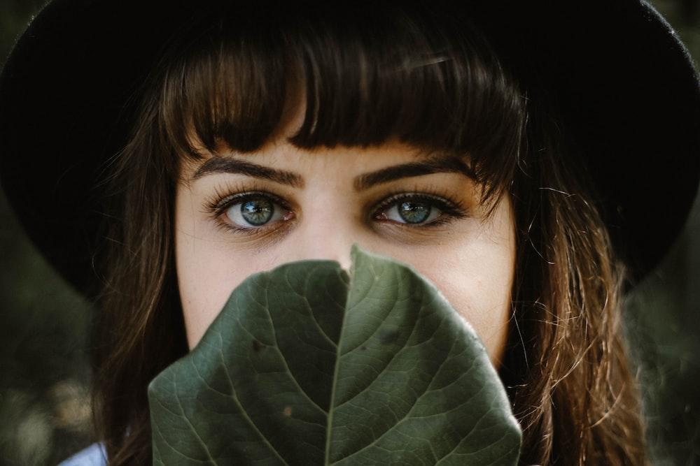 women beside green leaf