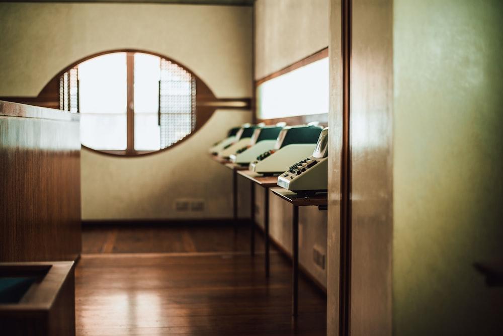blue typewriters inside room