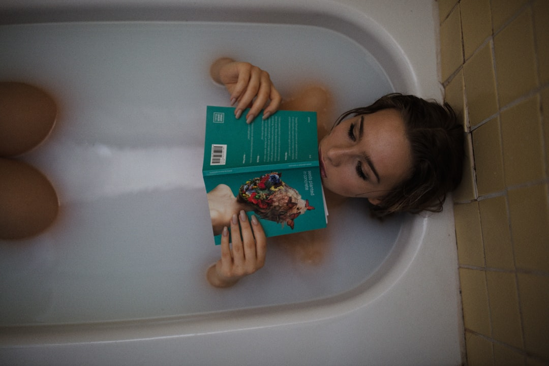 Relaxing in bath while reading book