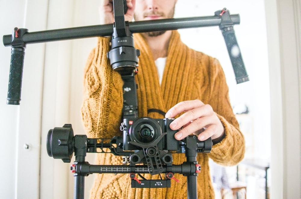 man holding black studio camera set