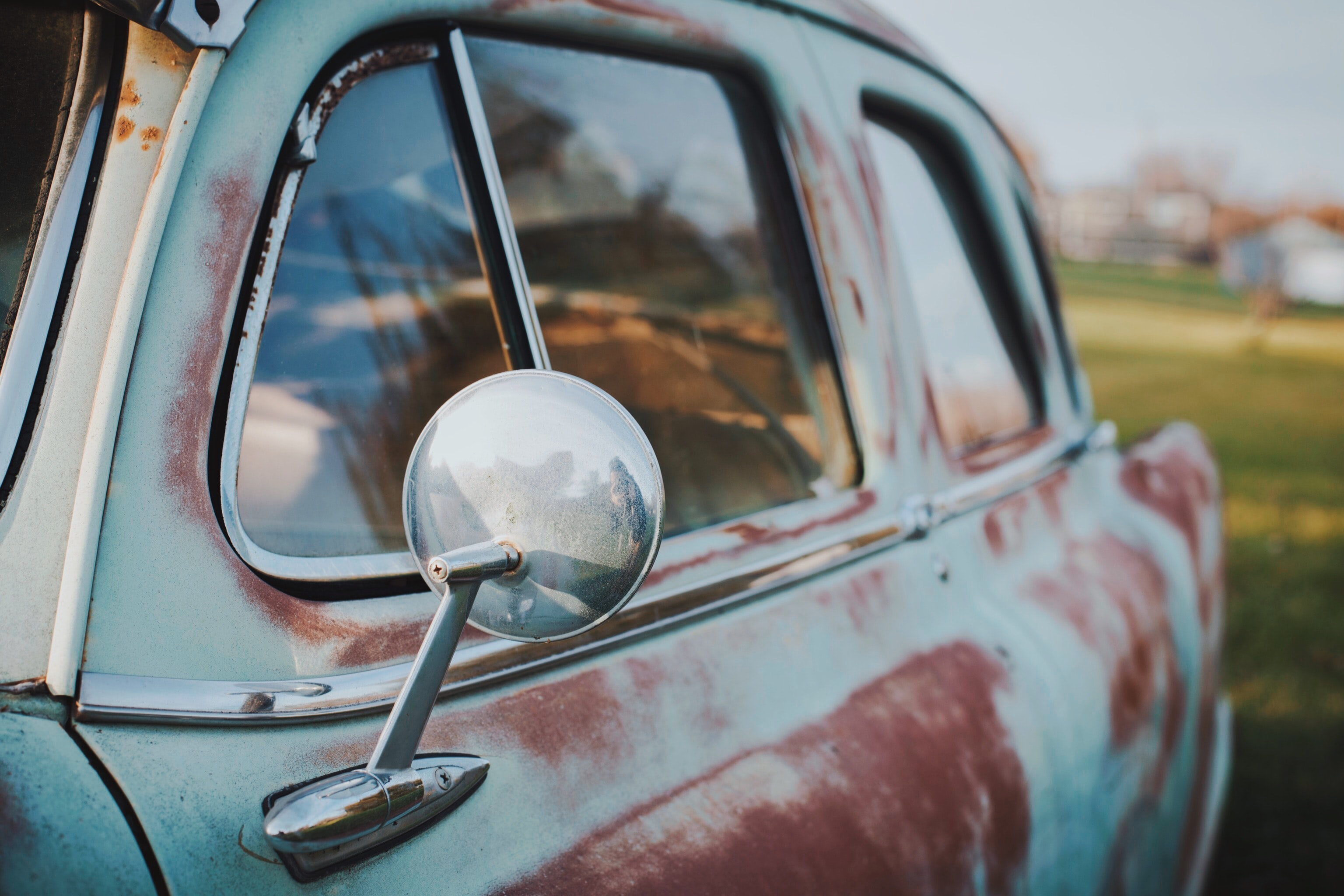selective focus photography of classic gray and brown car