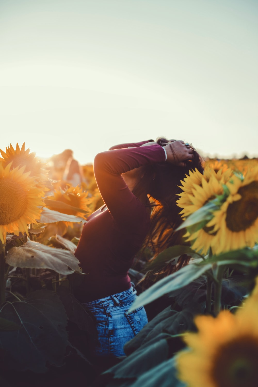 woman standing surrounded by sunflower