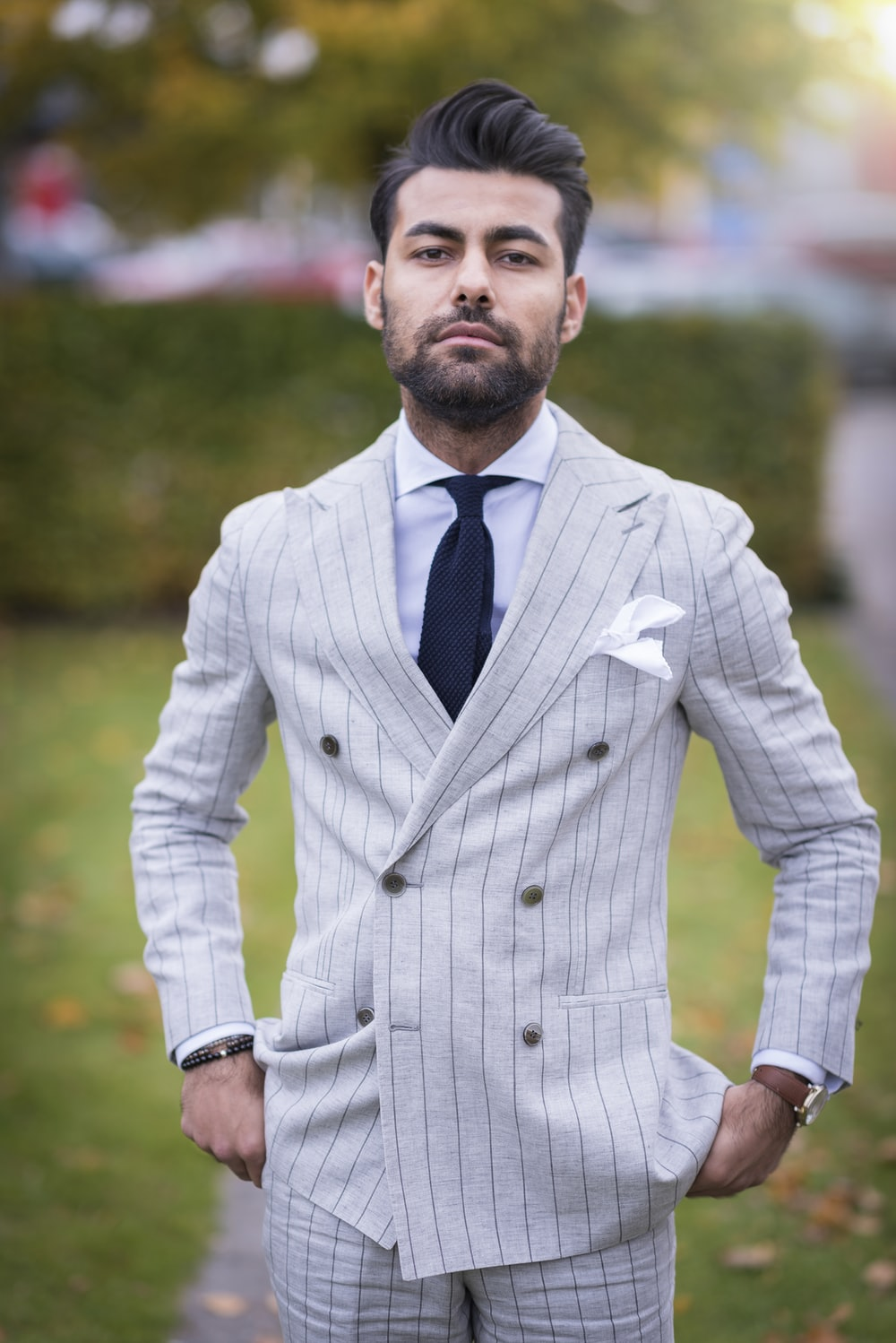 man in white and black pinstripe suit jacket