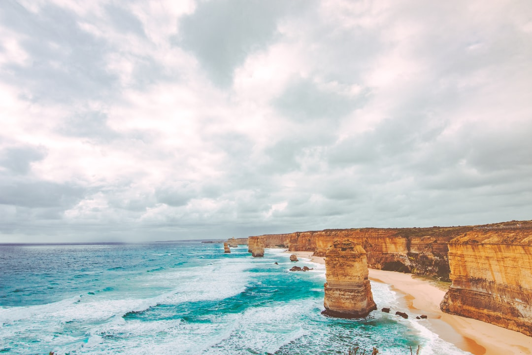 We travelled over 3000km to Australia, landed in Victoria. Drove from Point Cook in Melbourne all the way through the Great Ocean Road and finally culminated here on the Twelve Apostles site and it was supposed to be evening time with beautiful golden sun rays beating down on us but as always nature has a way of messing with our plans especially on this day with 10 degree temperatures and 65kmph winds beating smack onto our face and clouds covering any form of sunlight we could get into our shot. Nonethless nothing that day that was thrown at us could steal the sheer beauty of this view