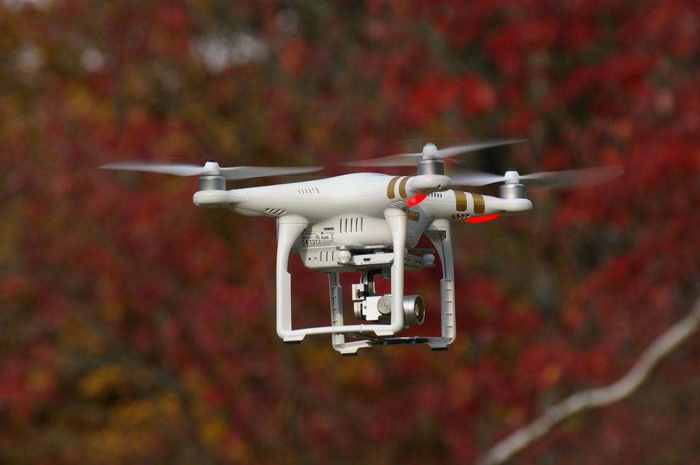 white and gold DJI Phantom 3 Professional selective focus photography