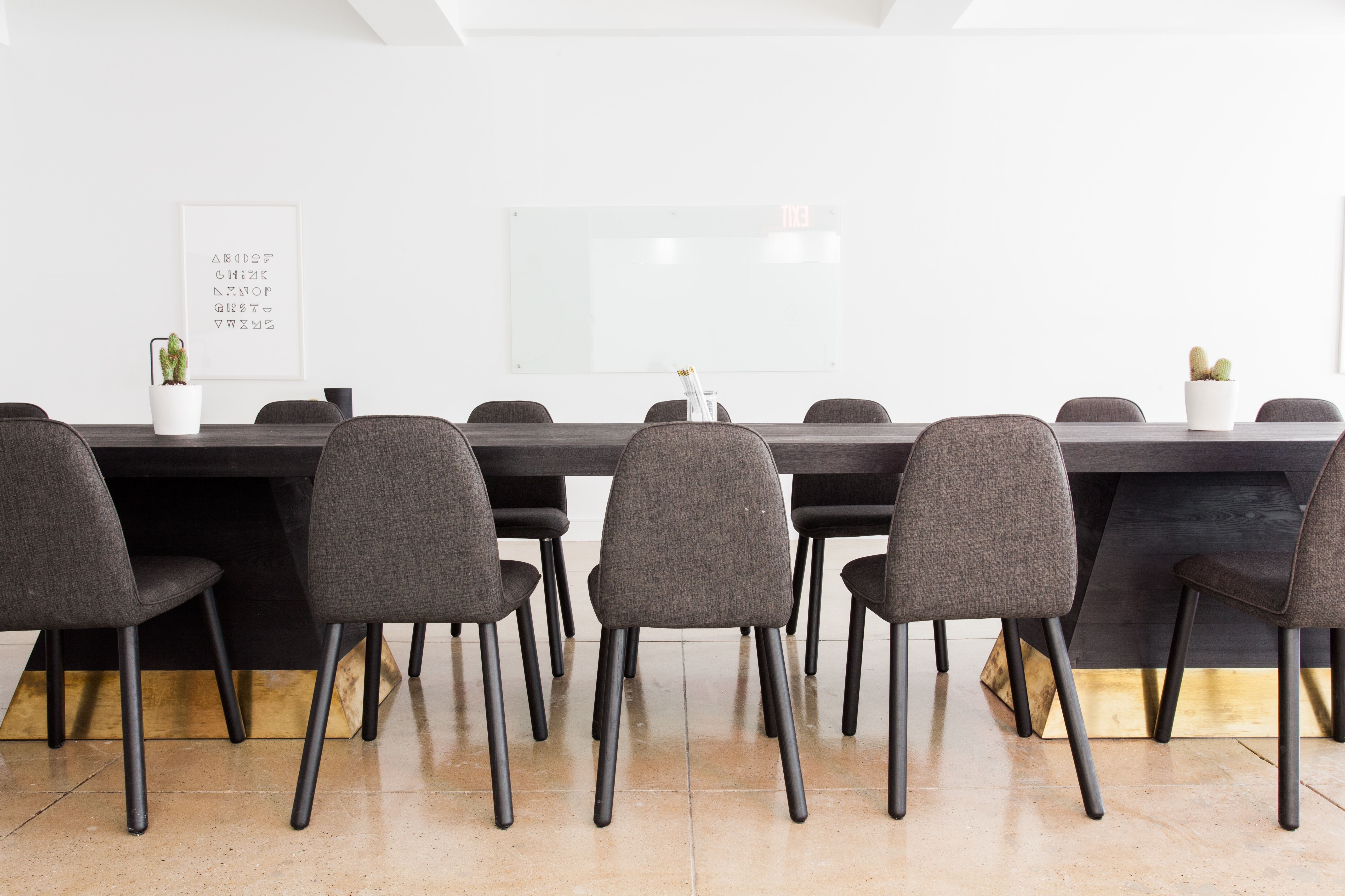 A row of chairs at a long table in a conference room
