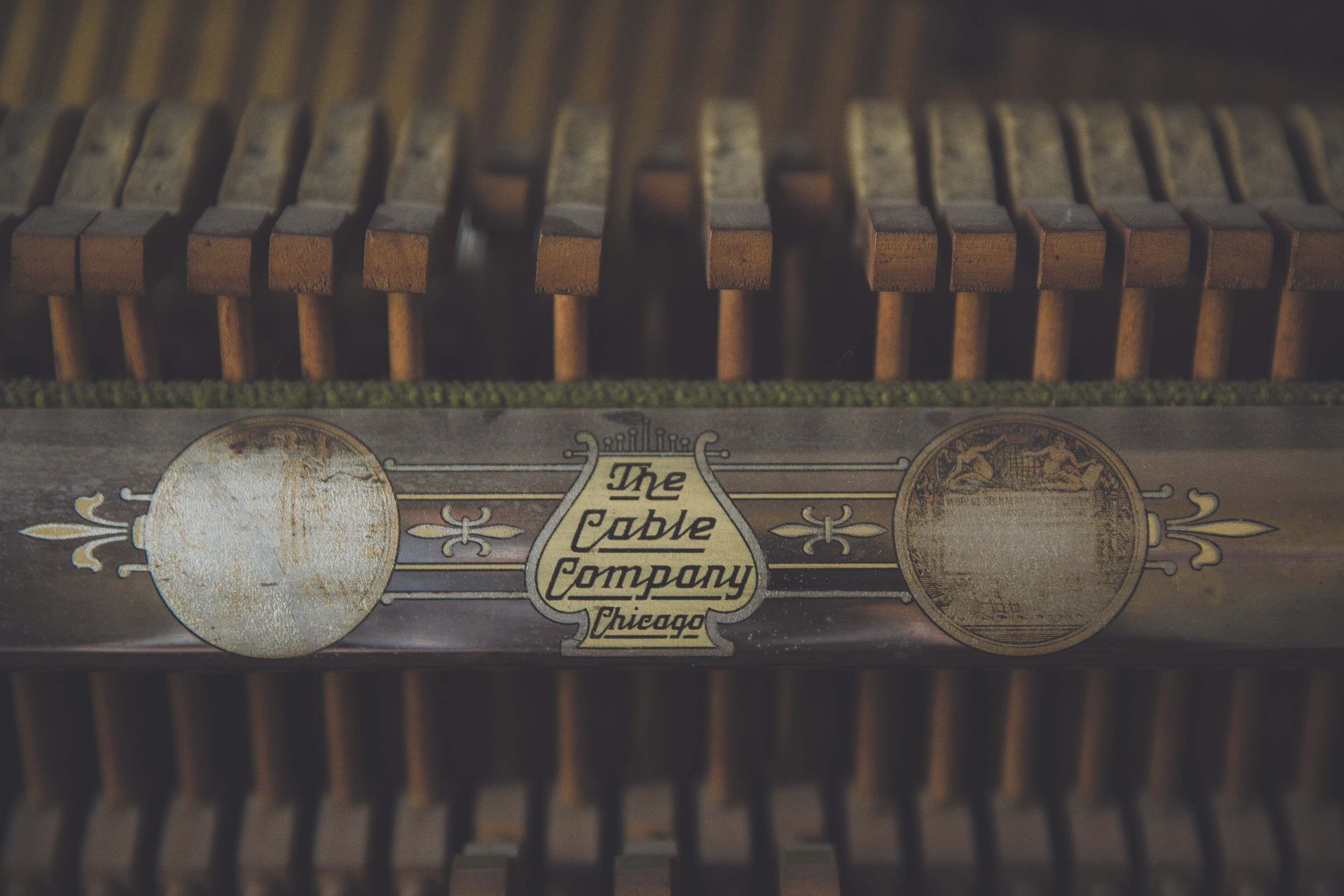 Macro shot of a dusty vintage piano.