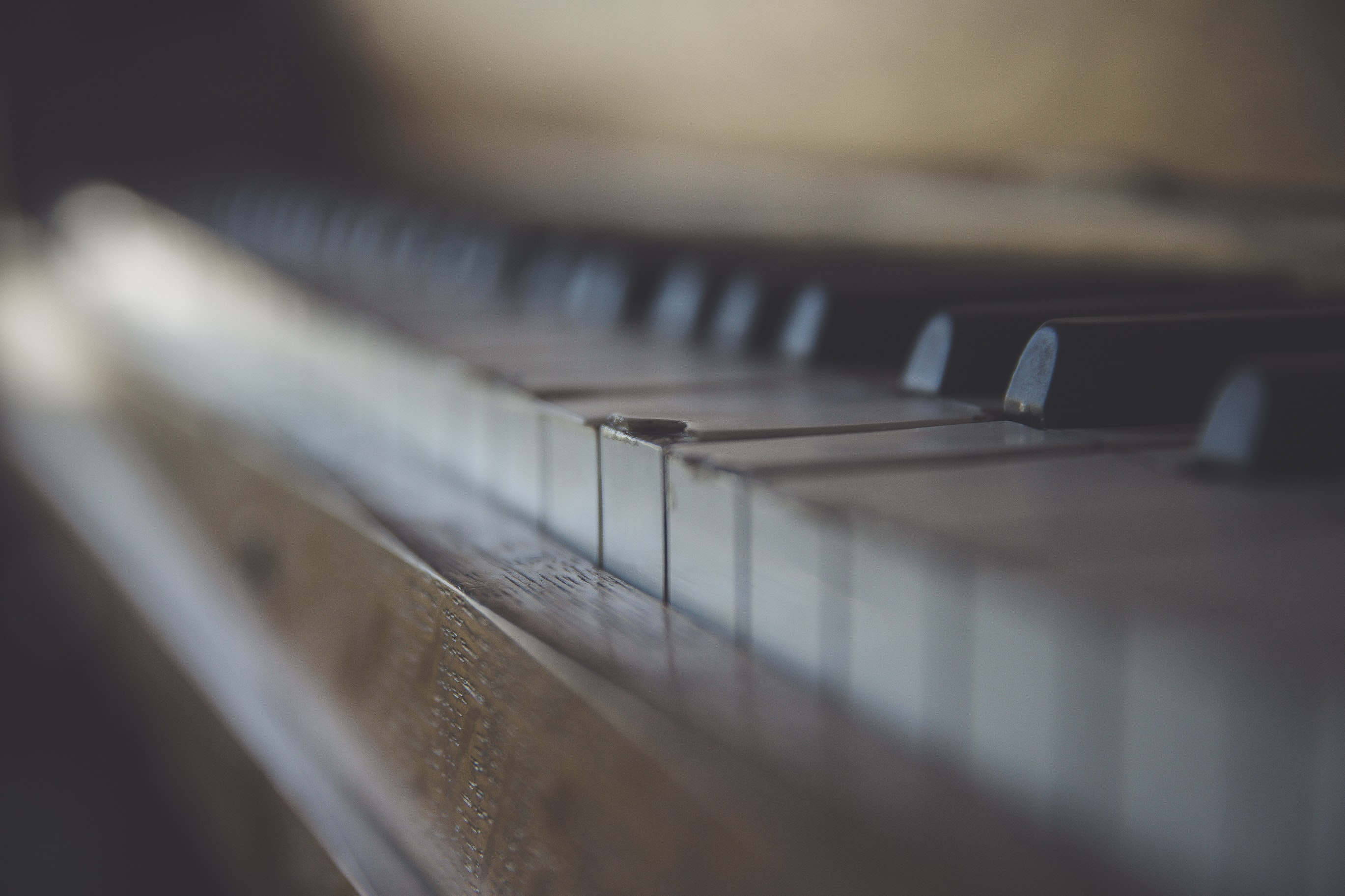 A blurry shot of the surface of a piano keyboard