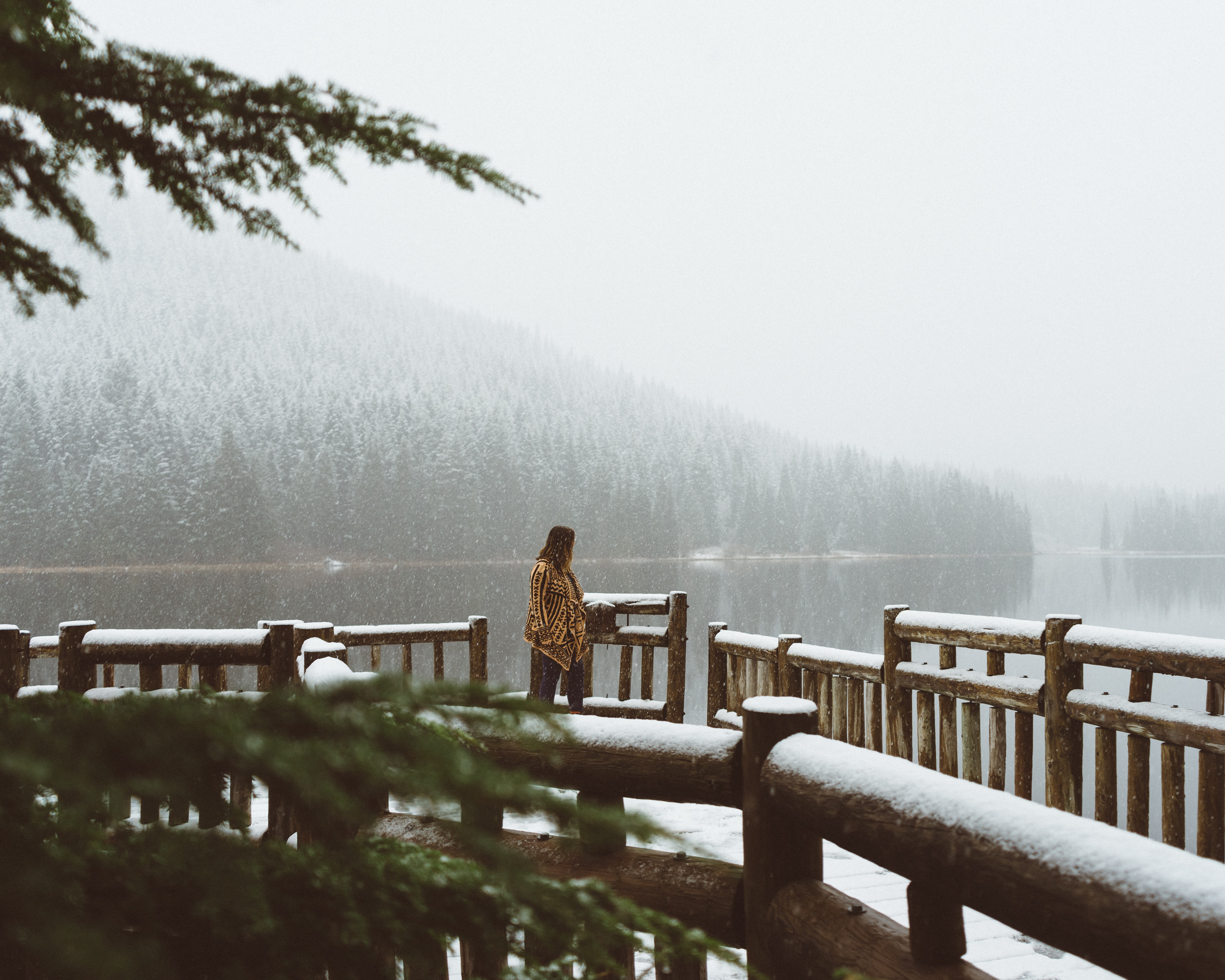 A woman looking out into Trillium Lake in Oregon