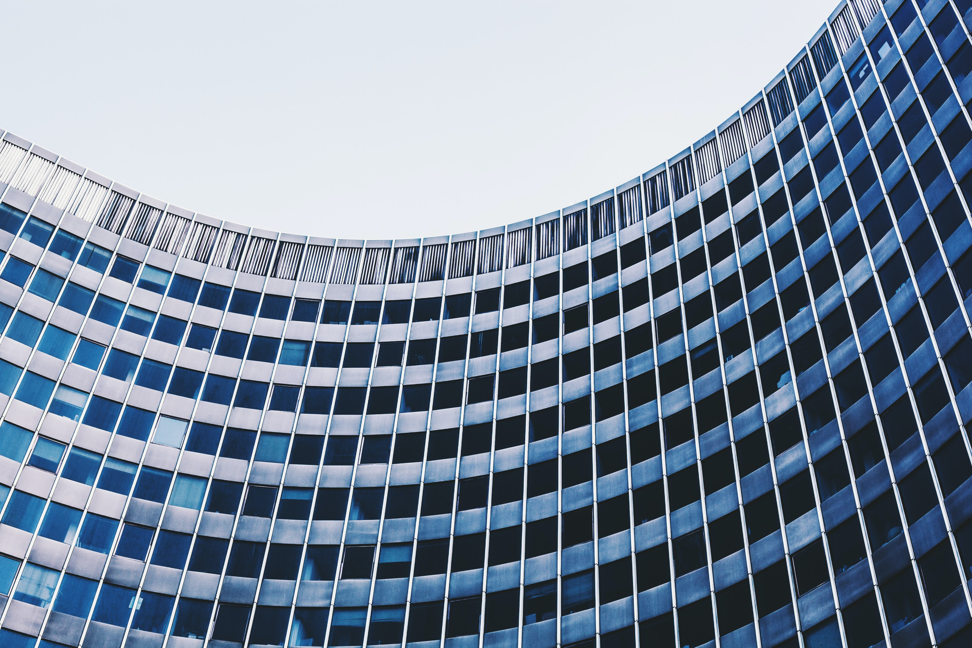 A curved facade of a government building in Brussels
