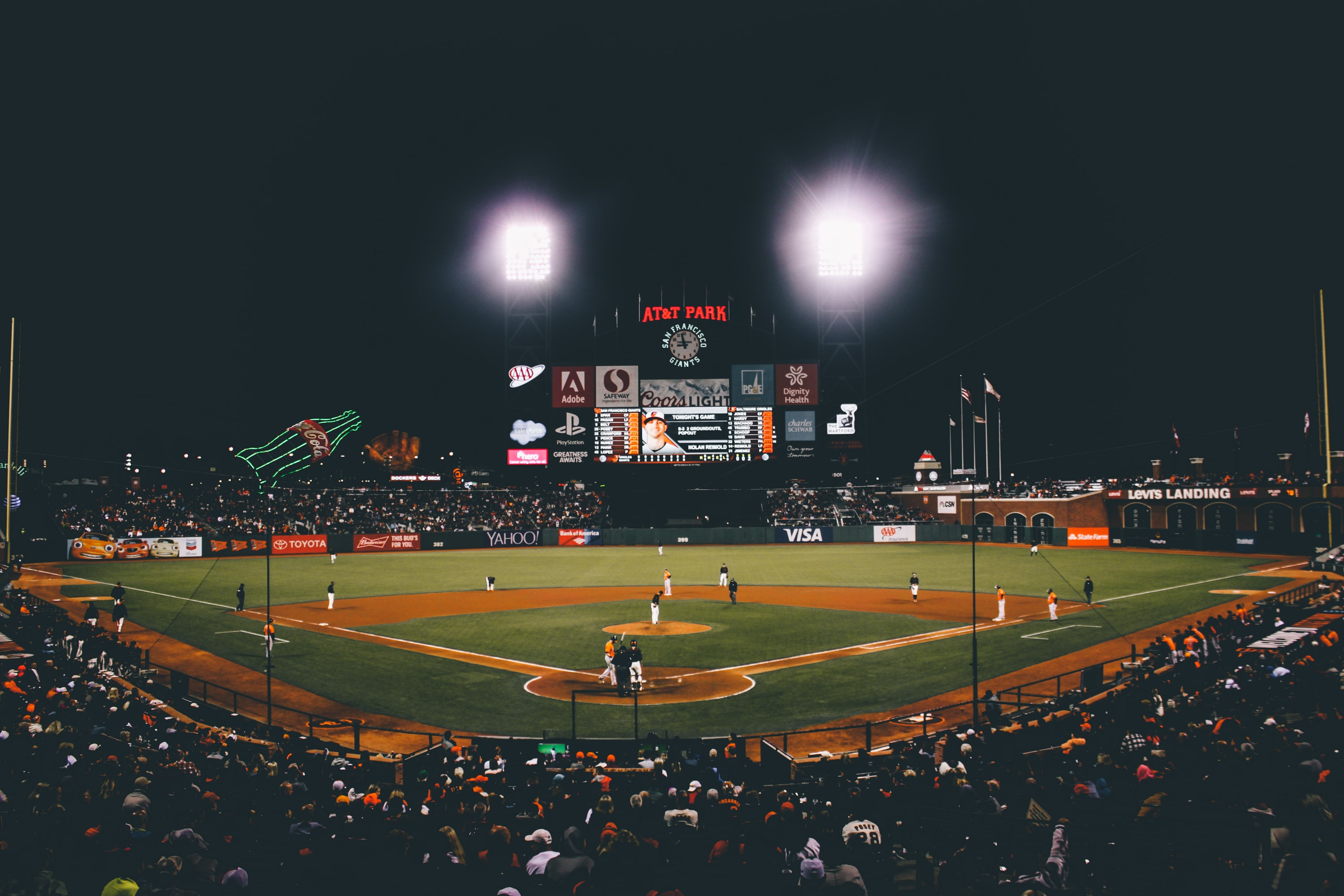 Crowd watching a baseball game at night in AT&T park in San Francisco