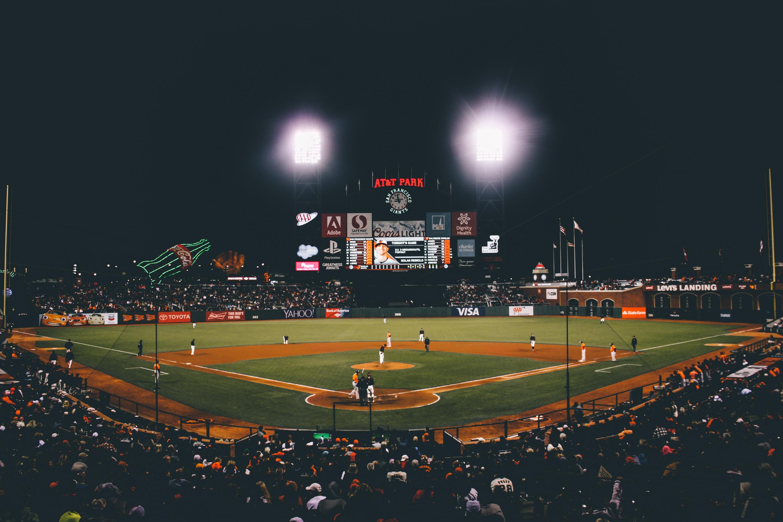 baseball player on baseball field during nighttime