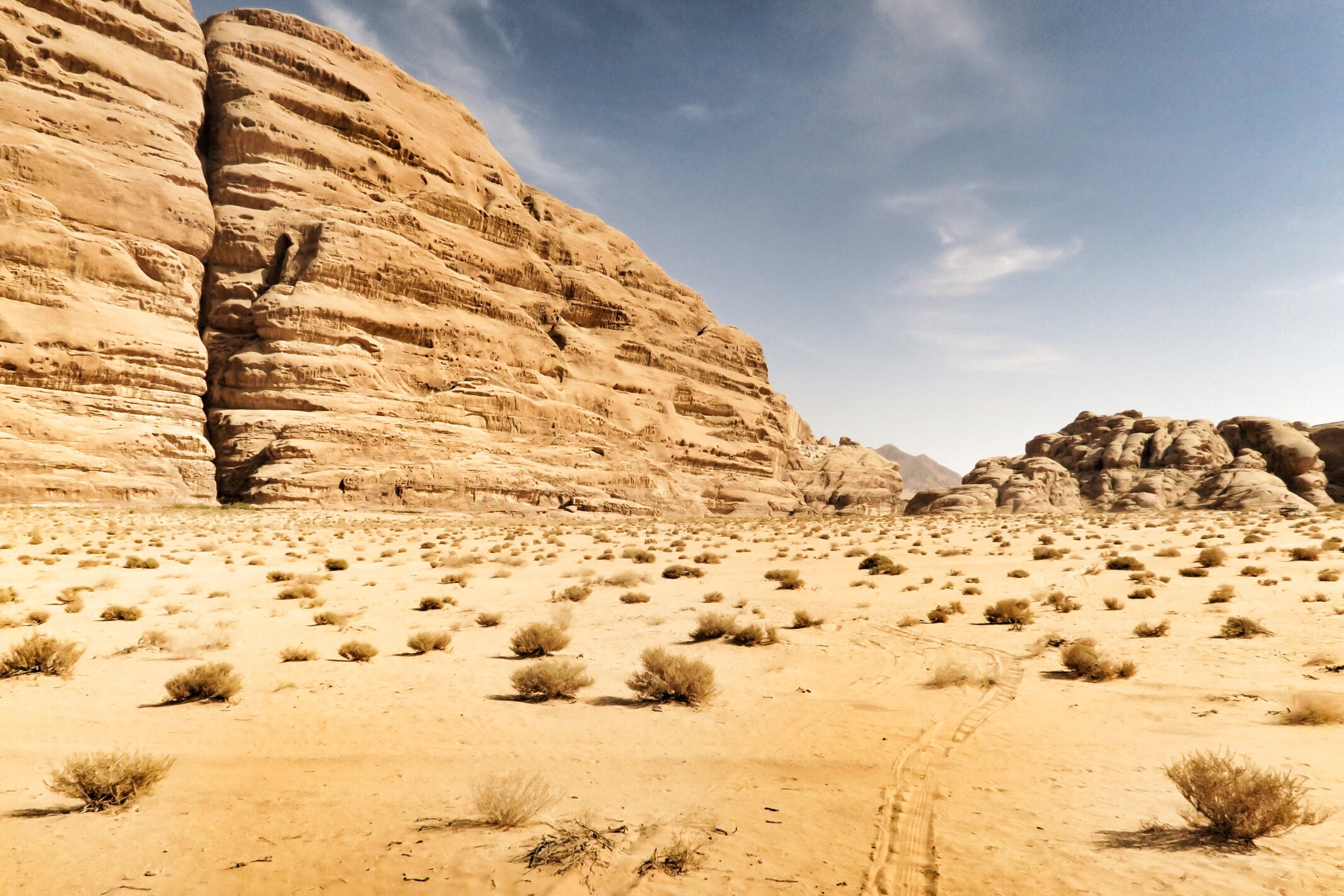 Sandy mountains in the arid valley of Wadi Rum Camping