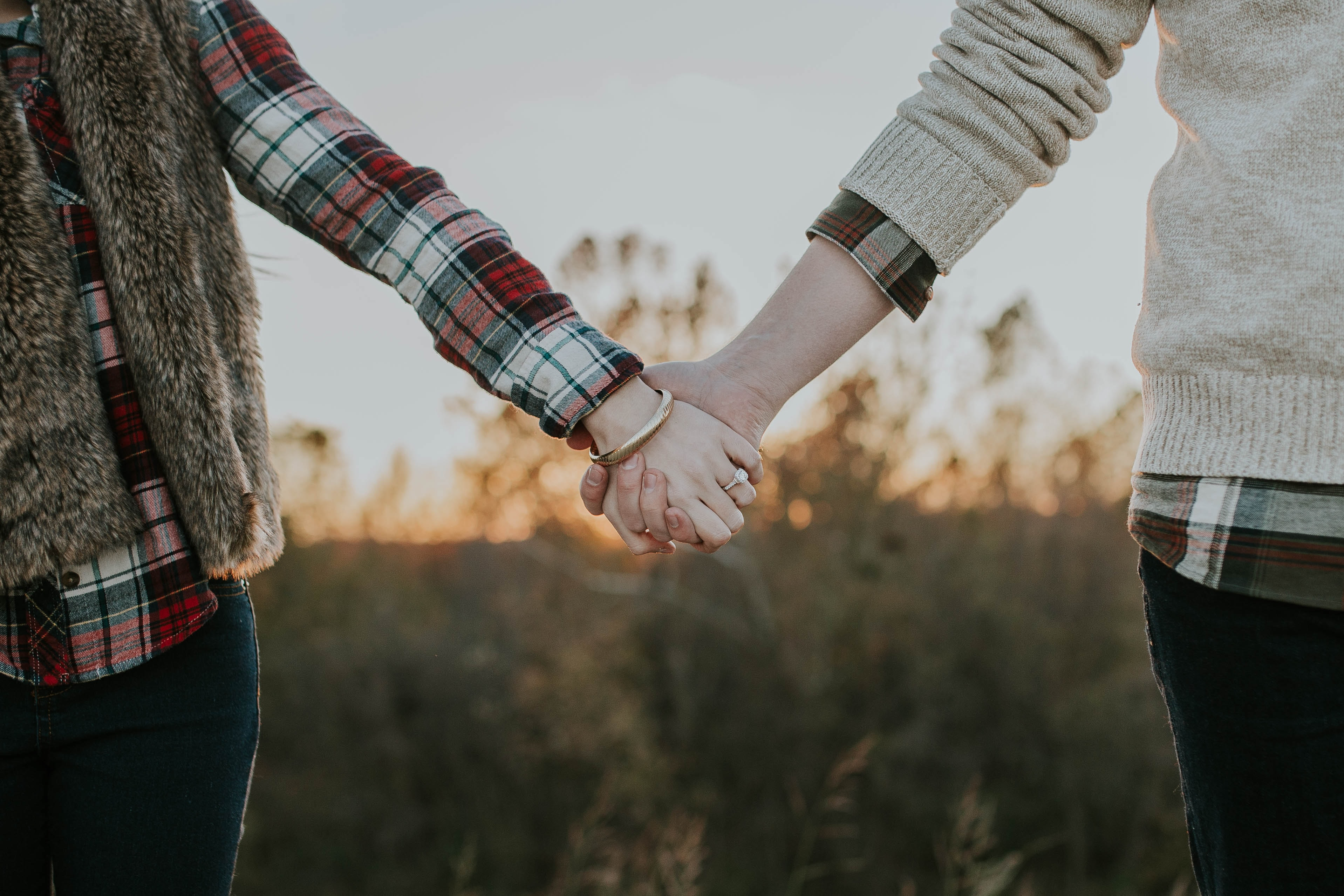 two person holding hands while standing
