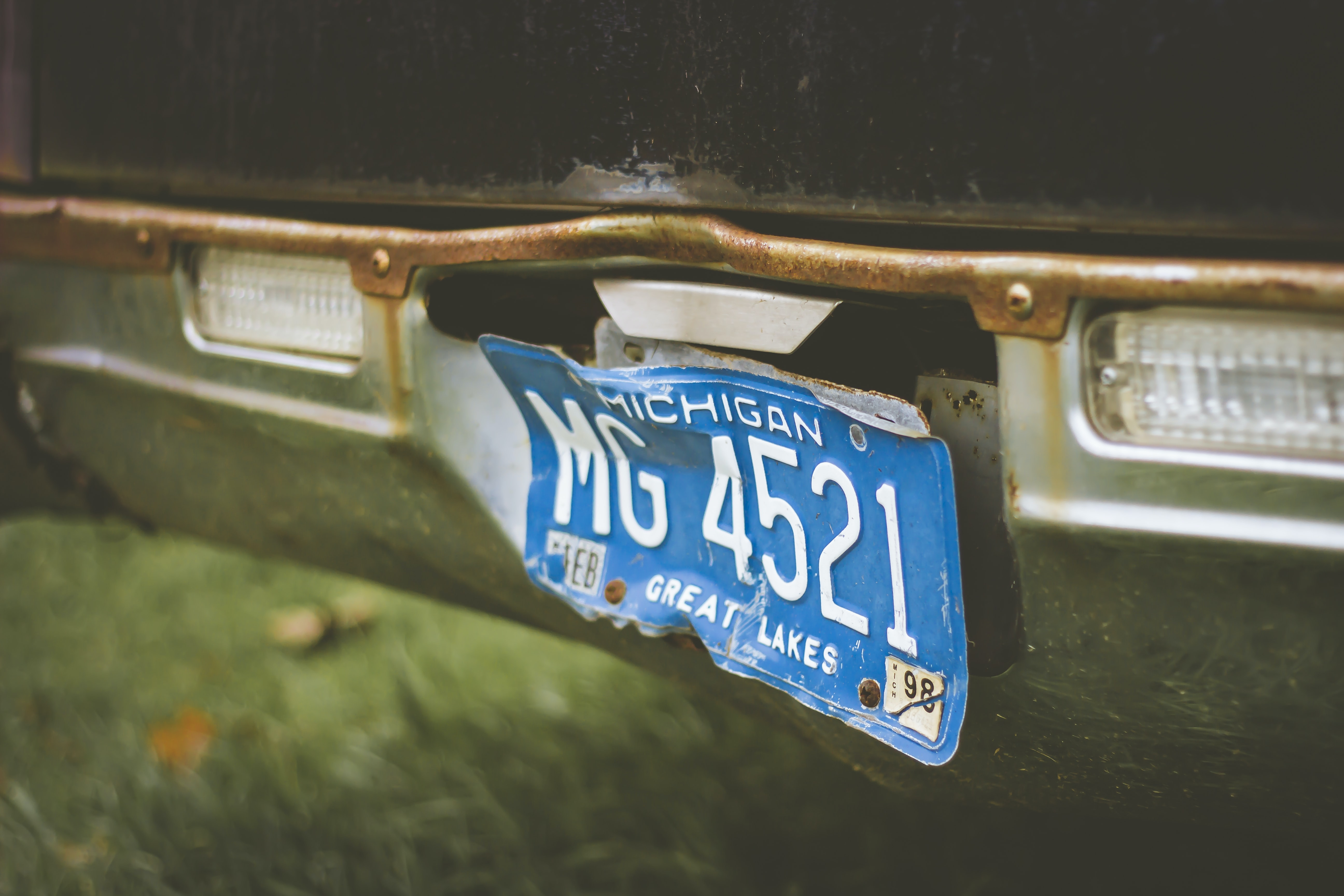 Close up of vintage broken blue Michigan license plate in Ashley