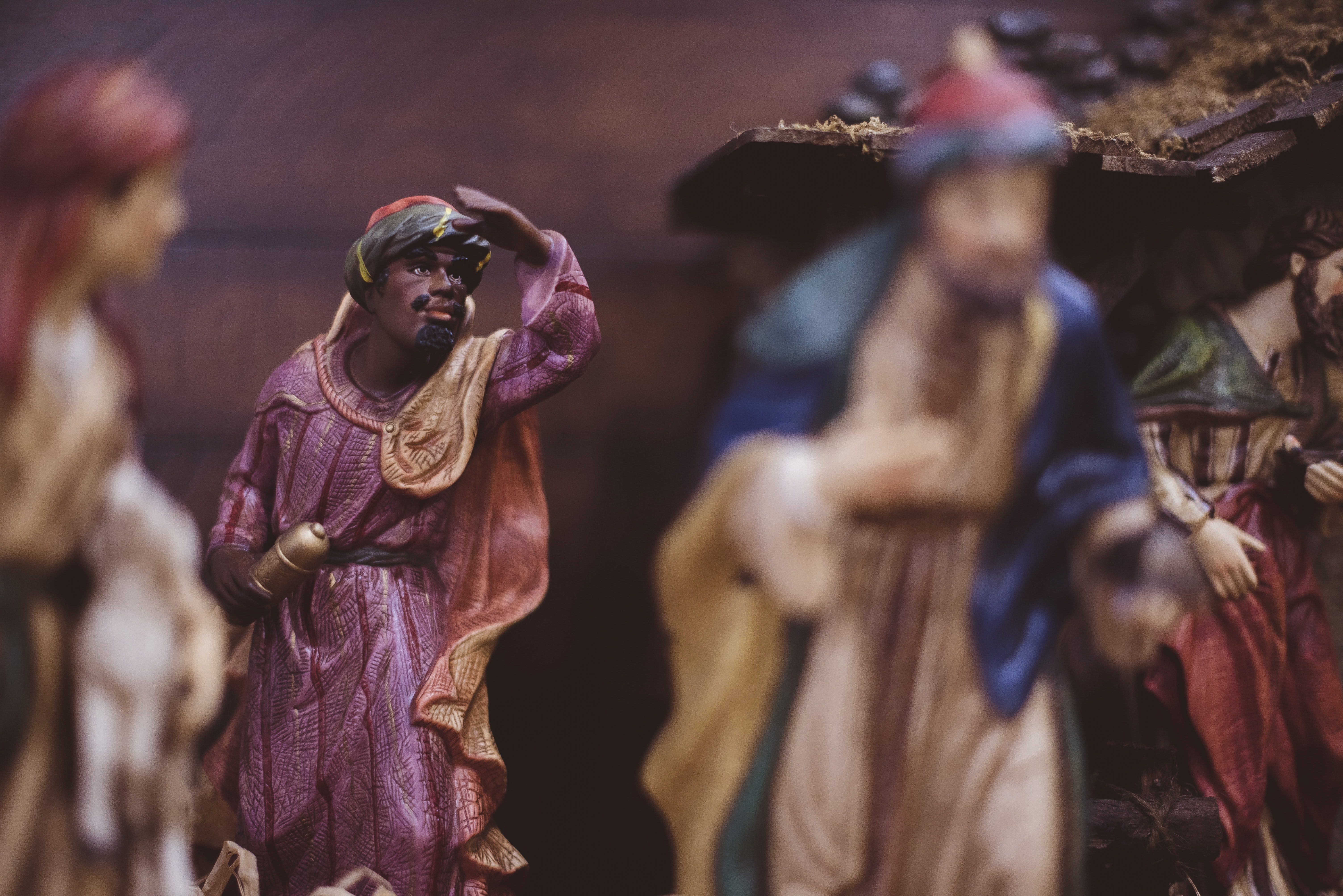 Out-of-focus Christmas decorations with wise men in a religious manger scene