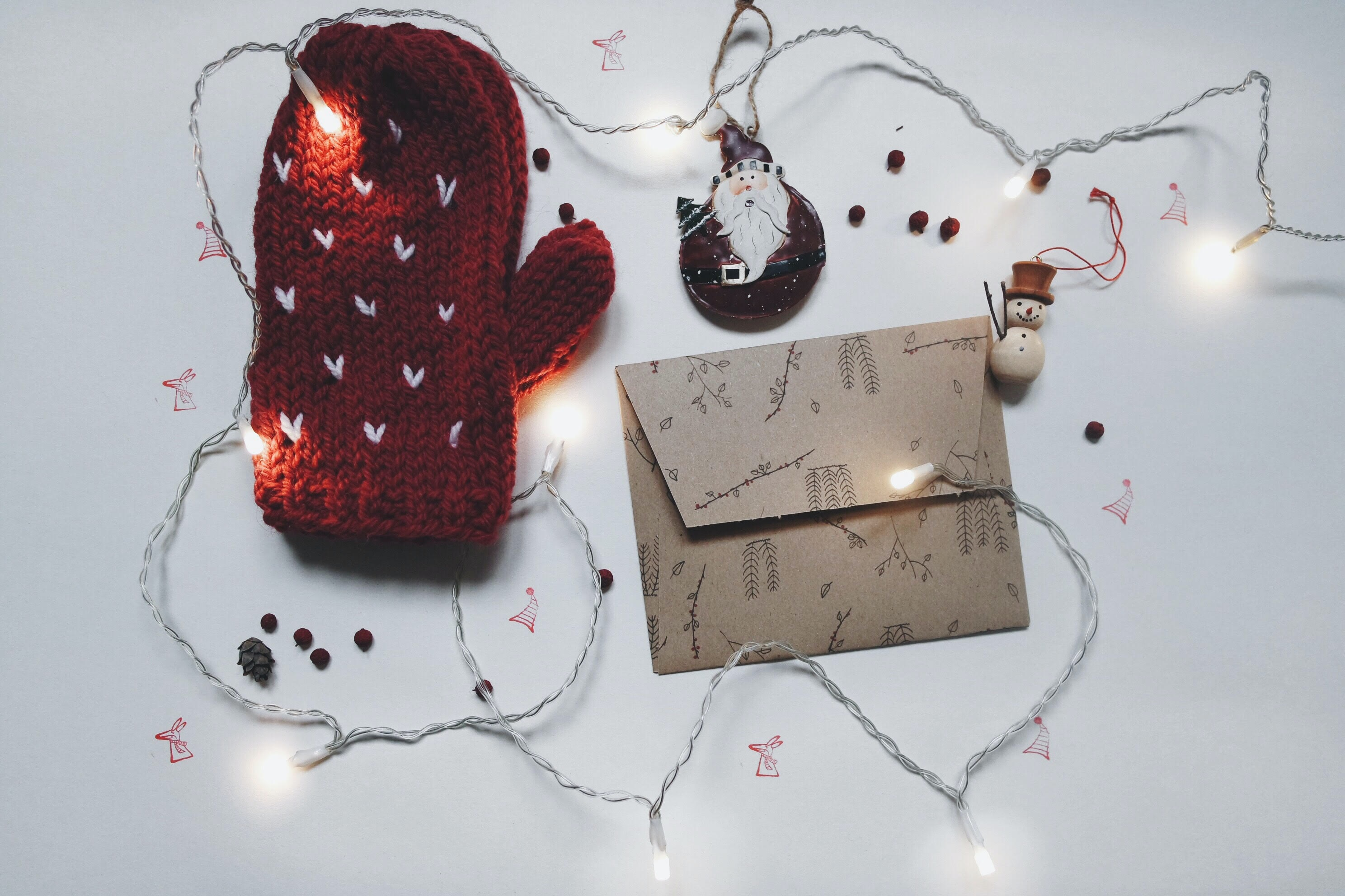 A winter mitt, card envelope and string tree lights.
