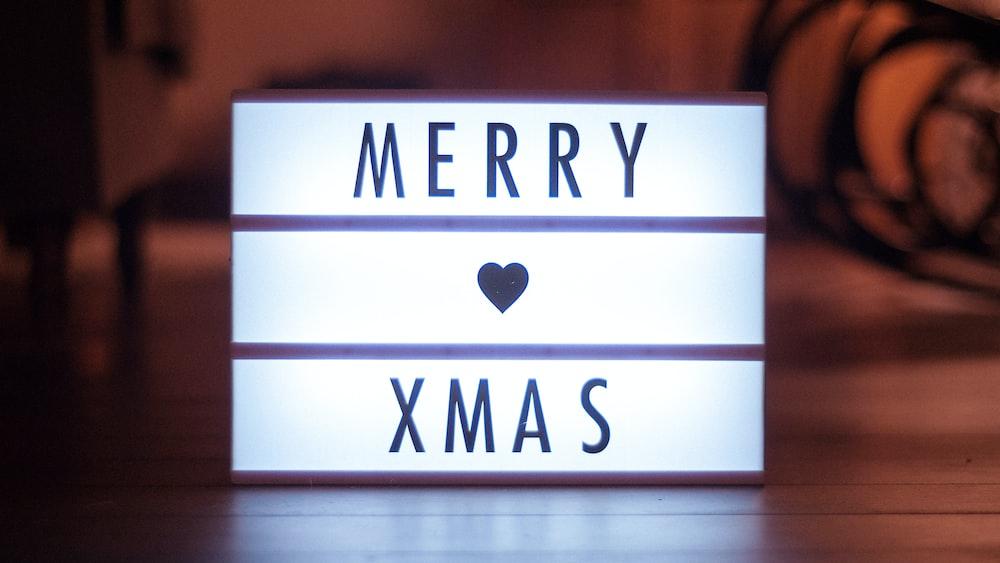 shallow focus photo of Merry Xmas LED signage