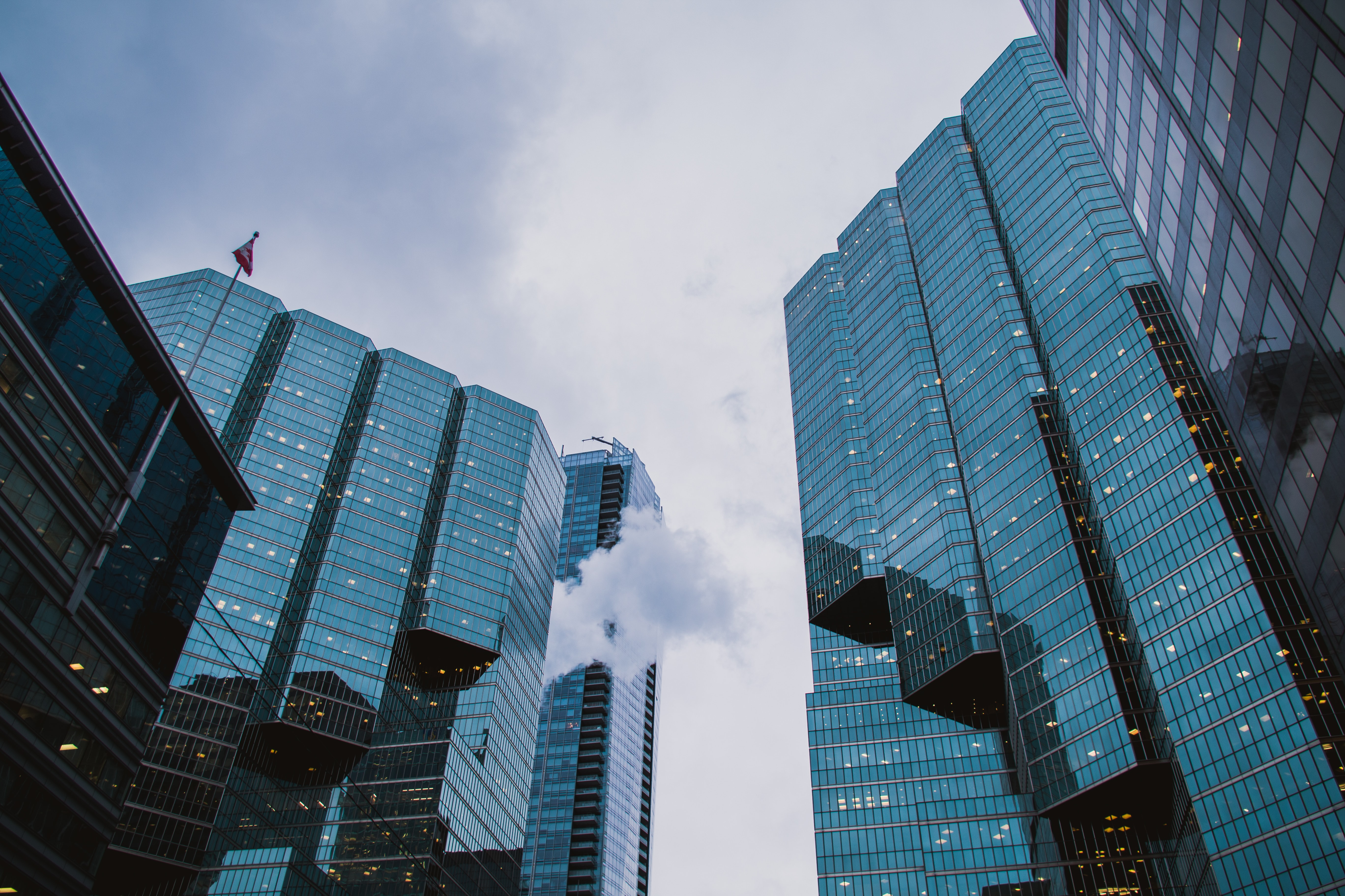 Wide glass facades of modern office buildings in Toronto