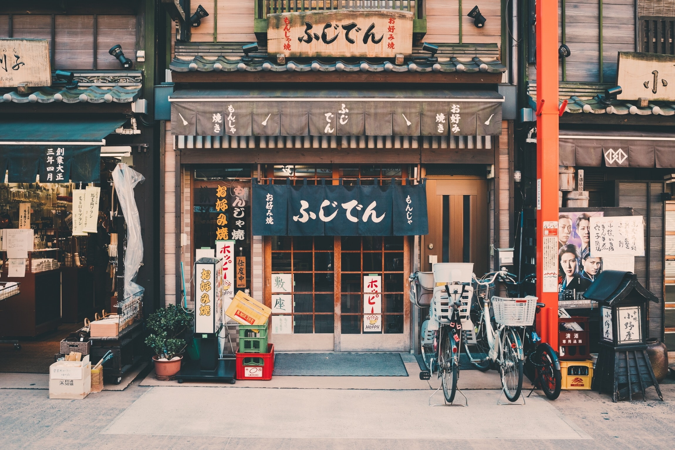 Bicycles parked at the entrance of a local restaurant in Tokyo