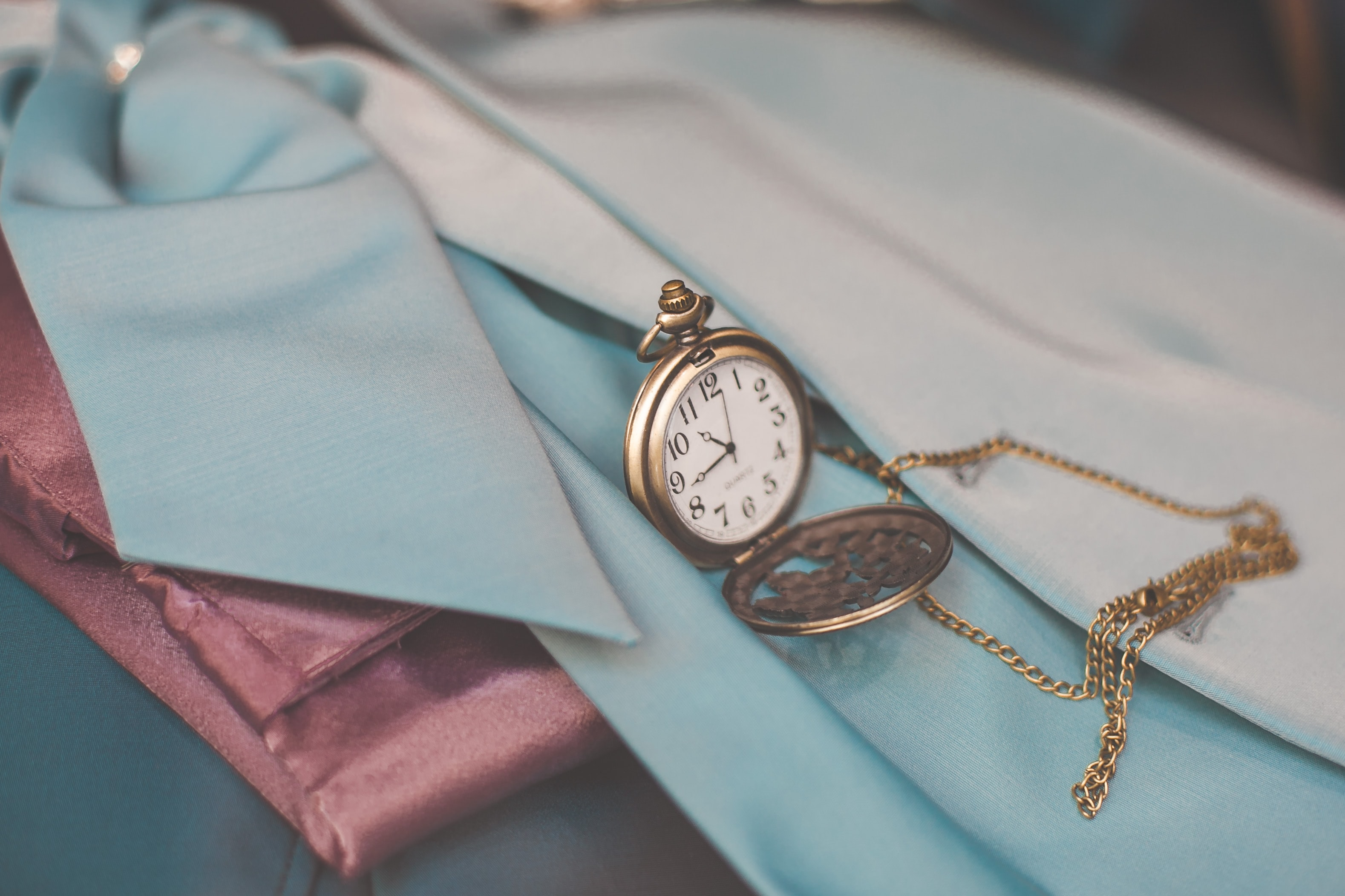 An antique pocket watch on a scarf